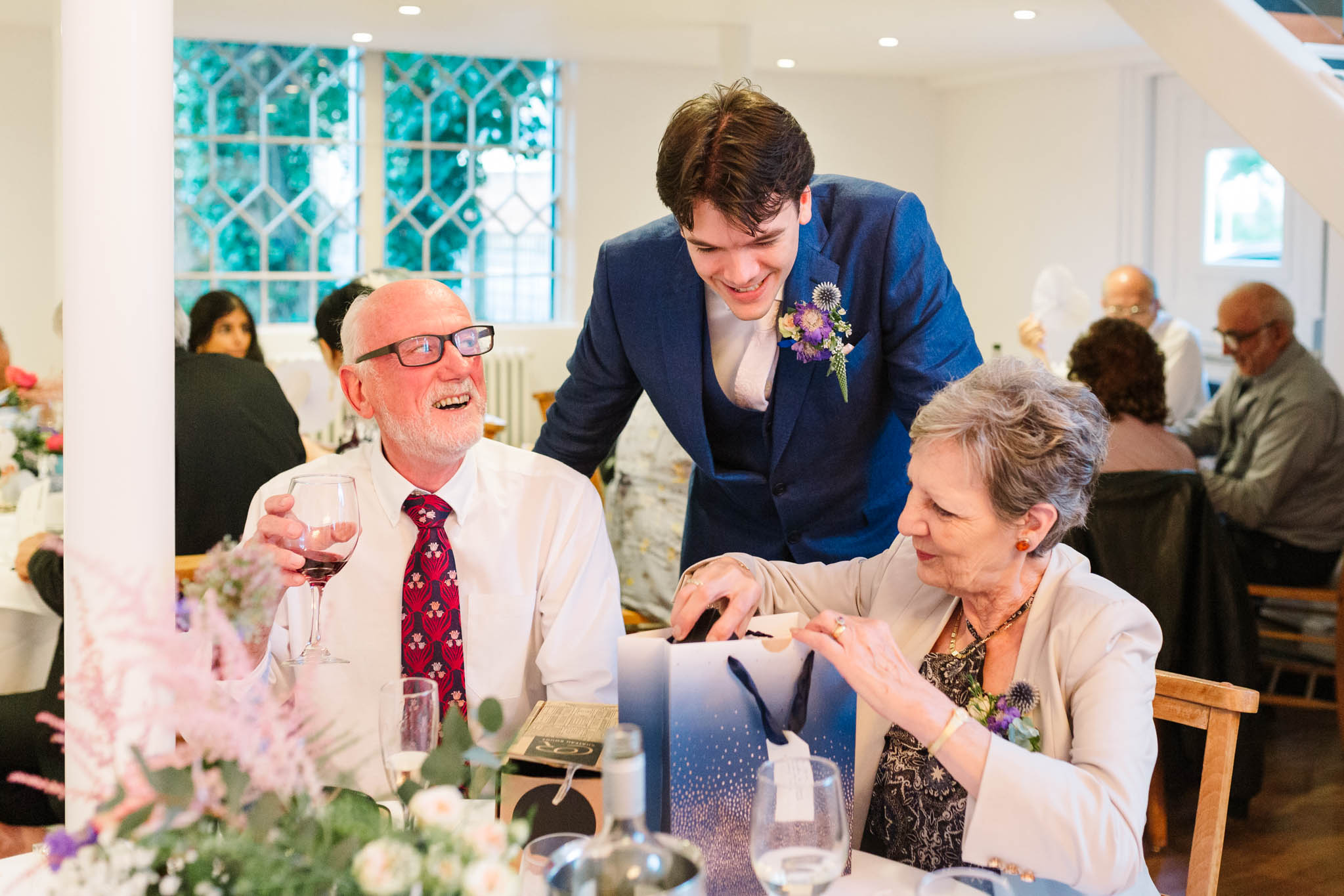 groom chatting and smiling with his parents