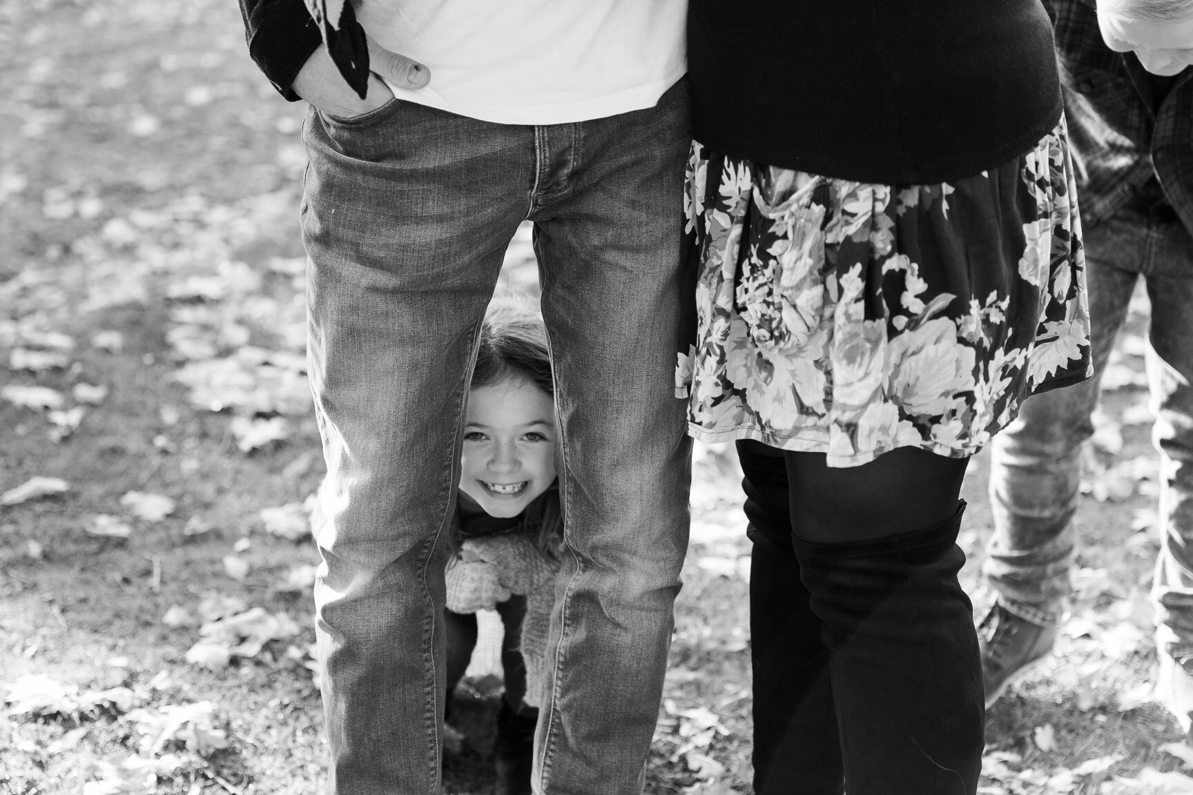 little girl peeping through legs