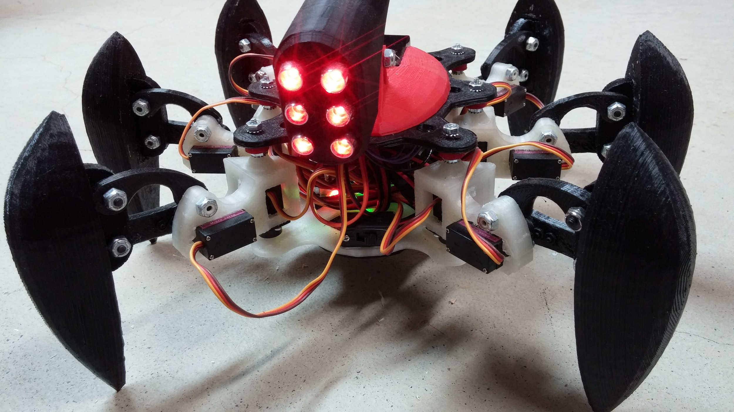 Hexapod - 3D printed 6 leg creature. Each leg has 2 servos (2 DOF). 3D parts can be found from the link:http://www.thingiverse.com/thing:176991