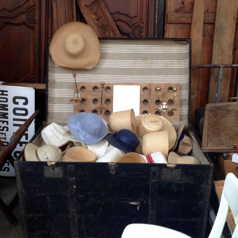 Trunk full of hats at l'Arrêt Deco.