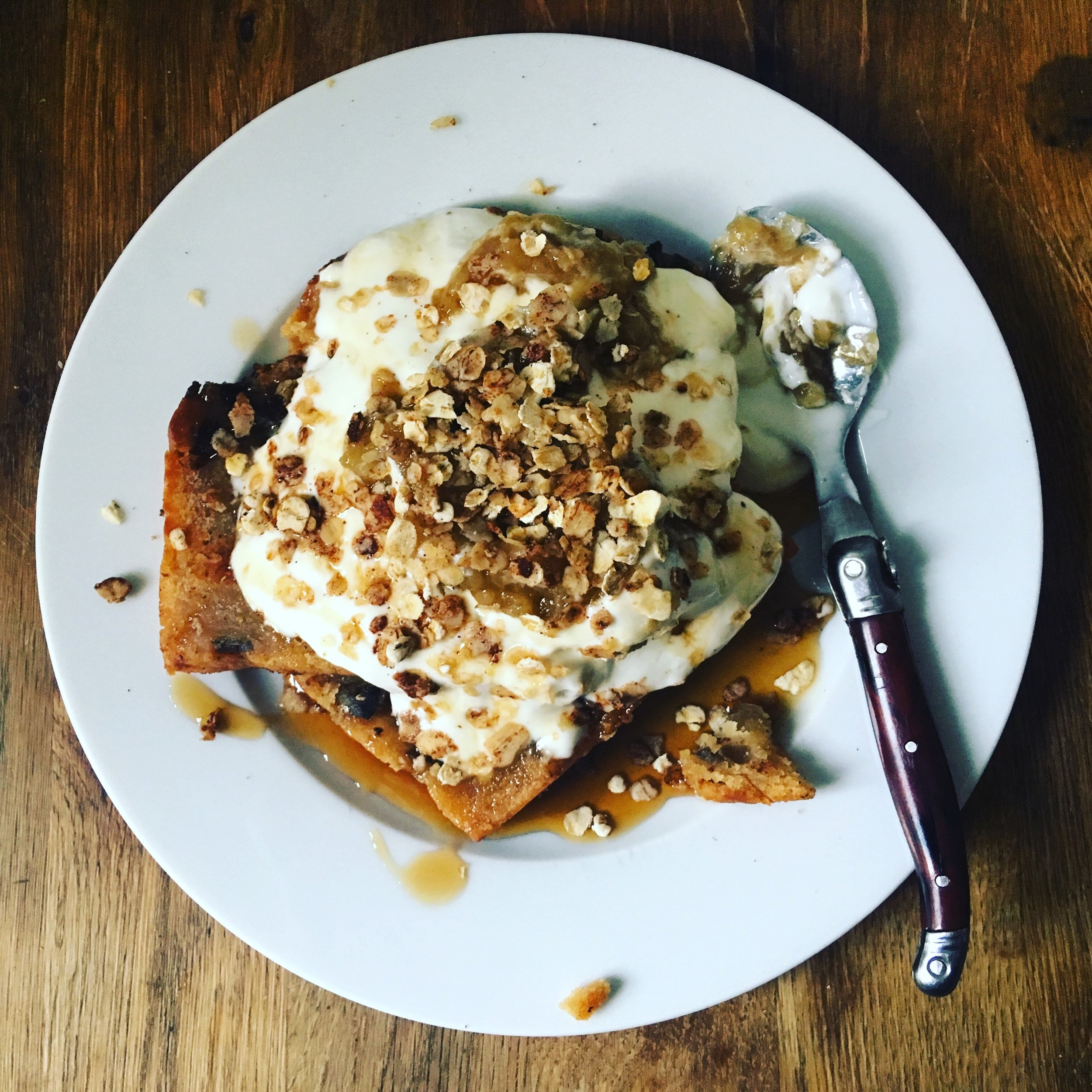 Banana Bread French Toast topped with creamy fromage blanc, maple syrup, caramelized bananas and cinnamon-toasted oats.