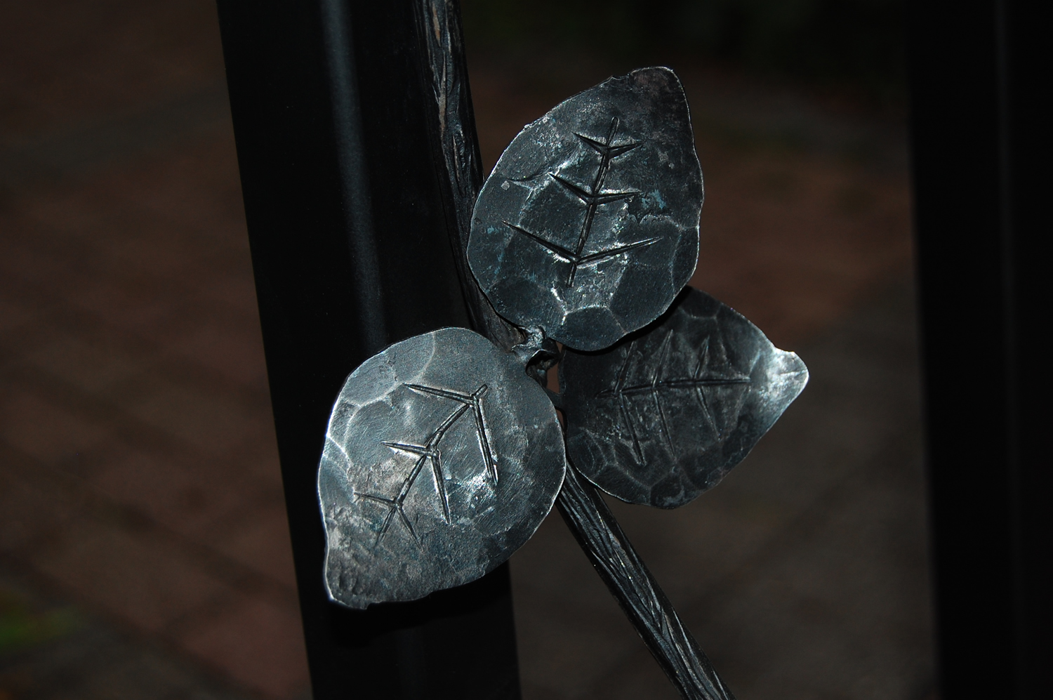 Hand forged steel leaves by Greg Johnson