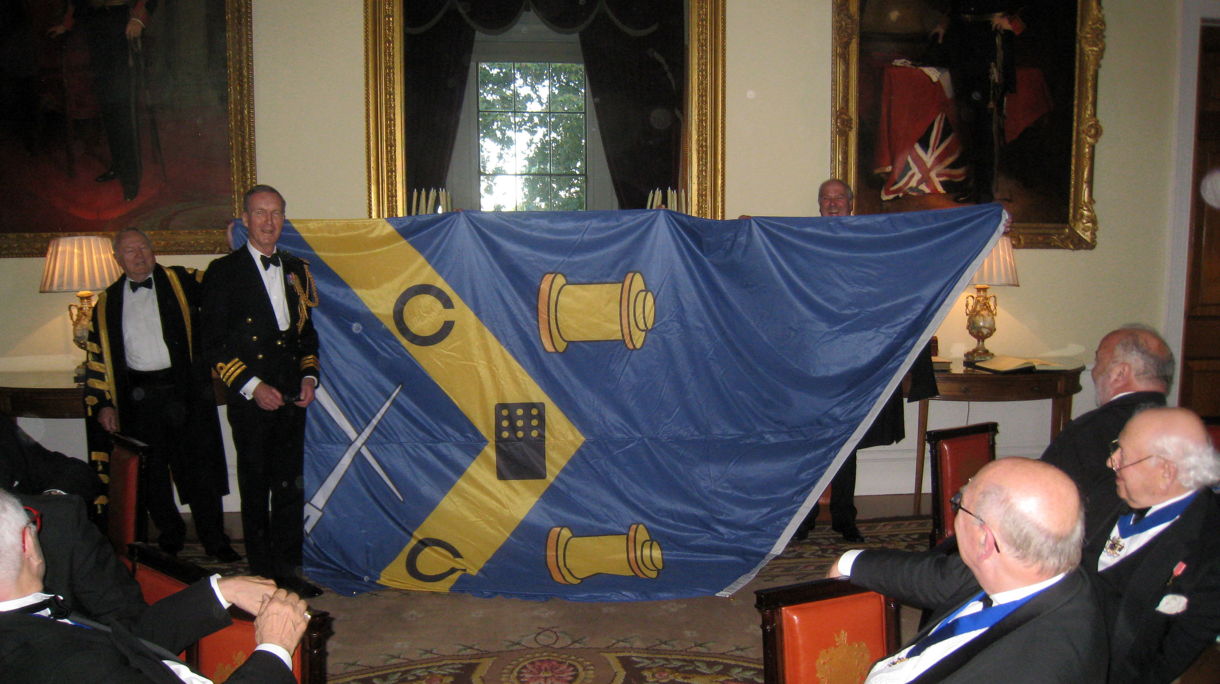 Hon Liveryman Cdr Robin House RN presenting GSWD with Livery Banner on his retirement as Clerk