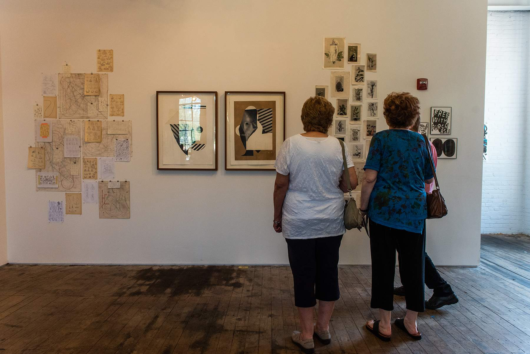 Art enthusiasts look at works on display at Atlas Studios during Newburgh Open Studios on Saturday.