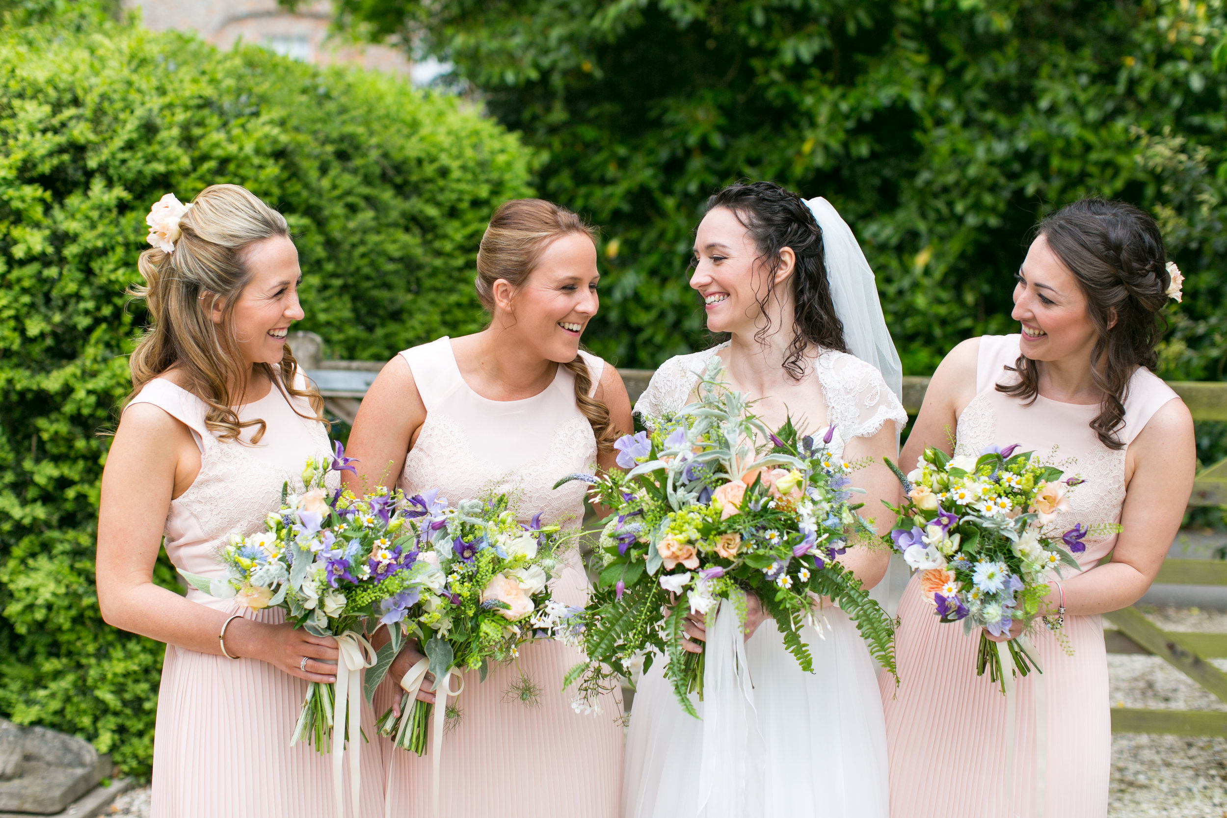 Kerri and her maids. I often have a colour swatch or a small photograph from which to work with to help pull together a collection of flowers to colour co-ordinate with the maids dress fabric. When I arrive on the morning of a wedding to deliver the bouquets, I am often eager to check my co-ordination skills have been successful! I was pretty chuffed with these flowers!