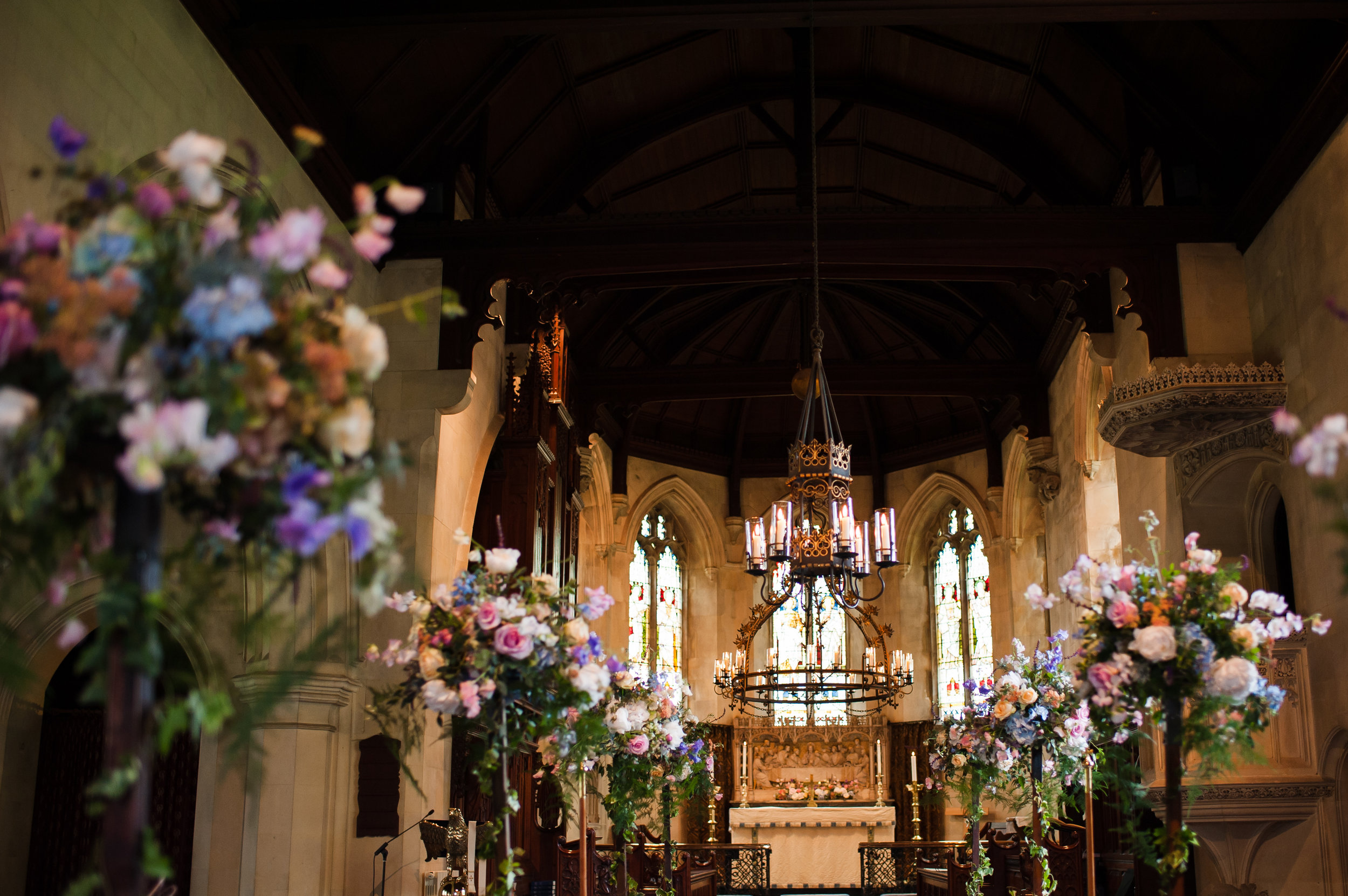We used tall poles along the aisle to flower the church at this gorgeous Hampshire wedding in May, the flowers were then transferred to the tables and placed on top on tall trumpet shaped clear vases.