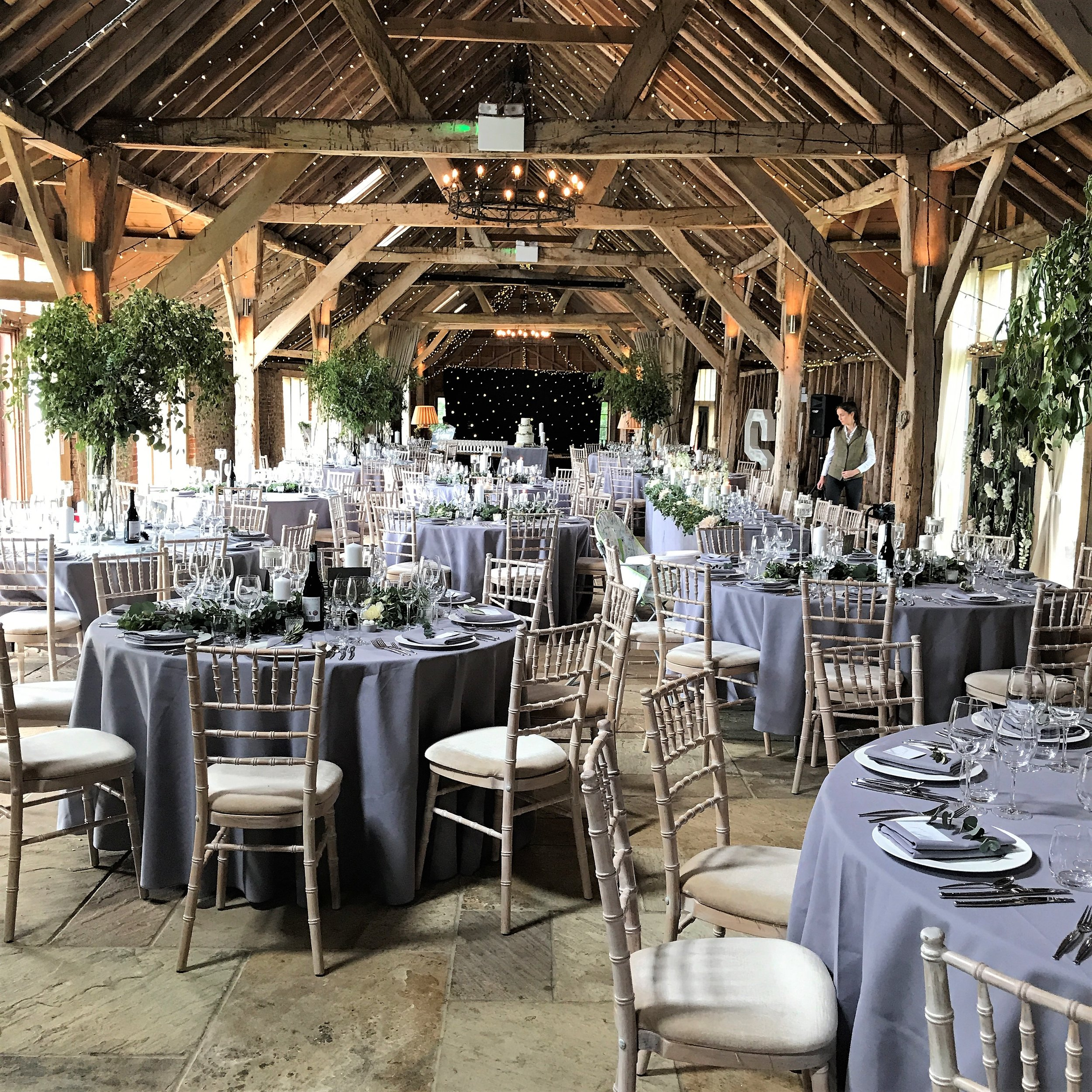 A beautiful all foliage wedding at Long Barn, Hampshire. We made garlands and squiggled them across half of the tables as tall vases filled with silver birch and contorted willow drew the eyes upwards. Add in lots and lots of candlelight -pillar, tea lights and floating candles and you have a simple but incredibly stylish look.