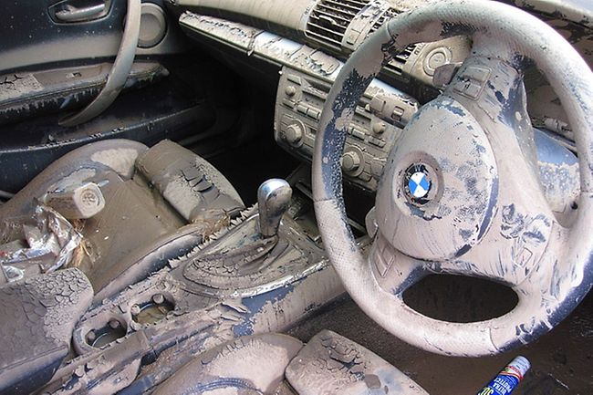 BMW interior destroyed by a climate related event, creating a increased demand for automotive fabric and production.