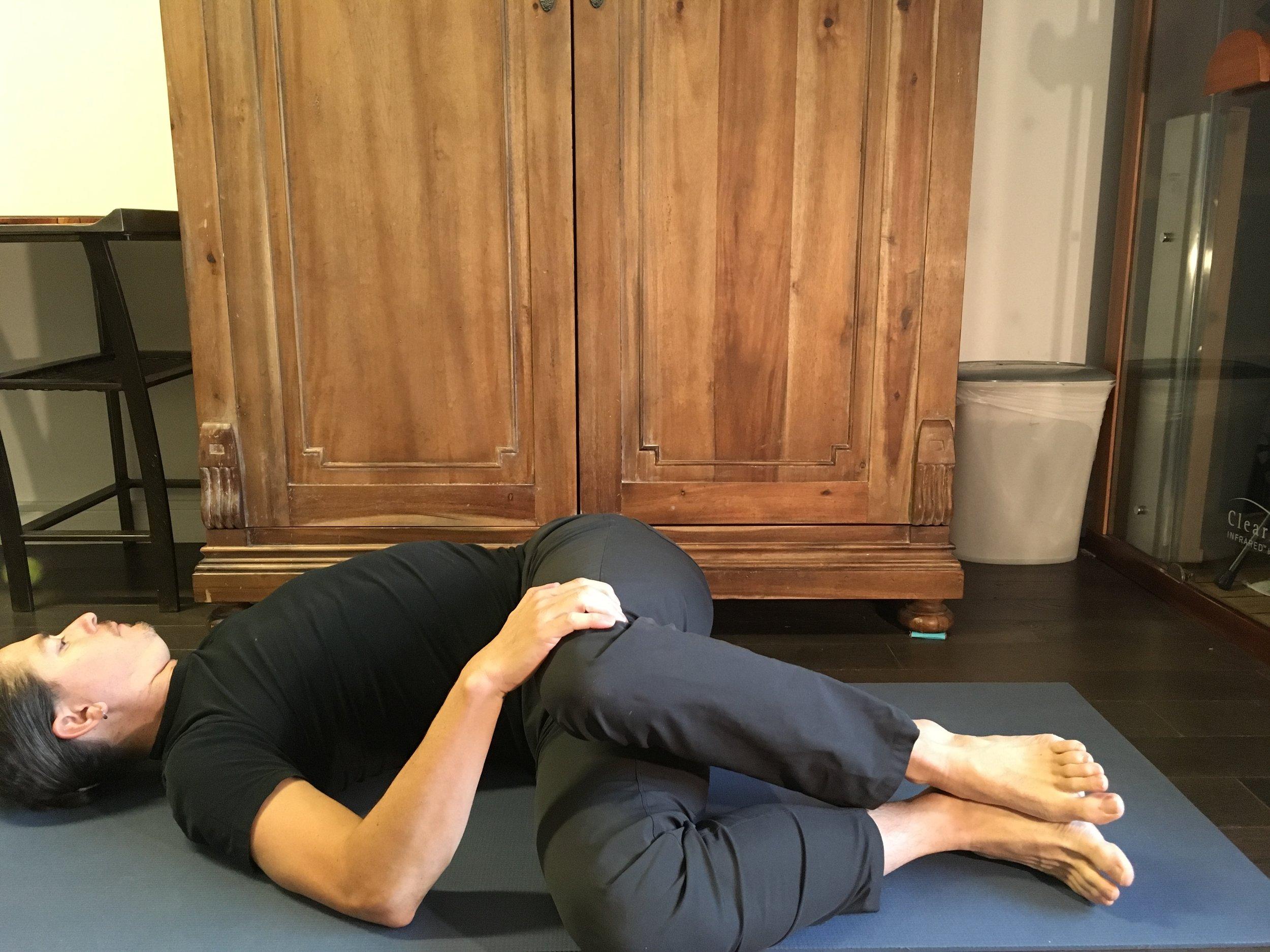 Yoga Poses for Sleep Jathraparivartanasana.jpeg