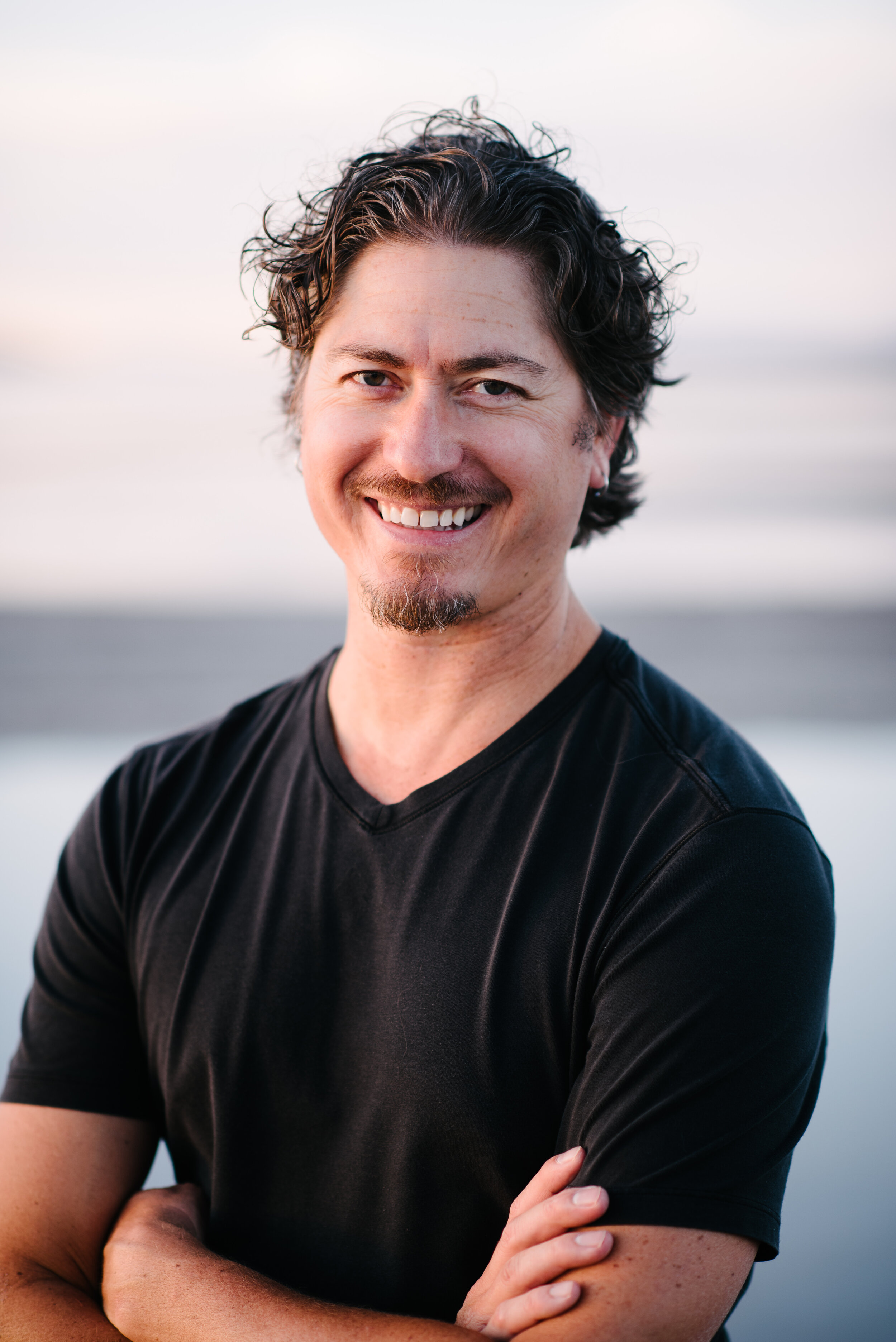 Scott Moore (E-RYT 500, YACEP, RYS) has been teaching yoga since 2003 and Yoga Nidra since 2008. His online Yoga Nidra teacher training has gained global attention and over 30,000 people have enjoyed his Yoga Nidra recordings on the Insight Meditation app. Scott was a professor of an accredited class, Yoga for Wellness, at Westminster College for 9 years and has also created programming and curriculum which incorporates Yoga Nidra for many hospitals and treatment facilities. Scott has also worked with many world-renowned performers and athletes to achieve optimal performance using Yoga Nidra. Scott writes for and has been featured in Yoga Journal, Mantra Magazine, Origin Magazine, Medium, Conscious Life News, Sivana East, and his own blog at scottmooreyoga.com/blog. Scott loves to travel to offer retreats, trainings, and workshops. Scott is currently living with his wife and son in Southern France.