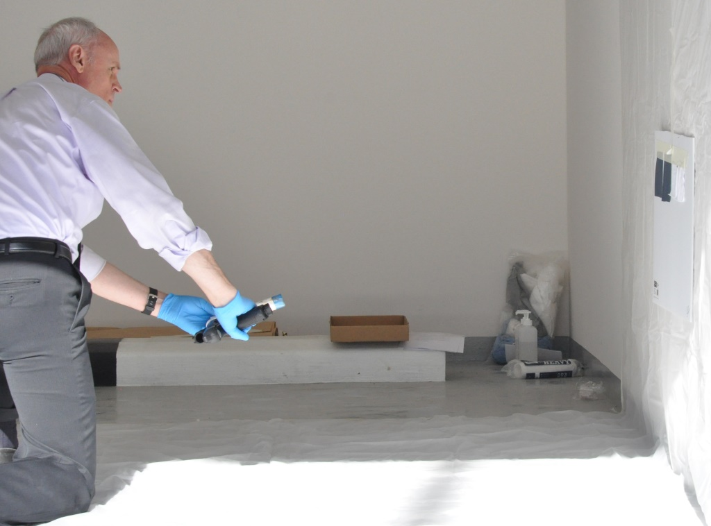 Ross using spatter gun to place small bloodstains on fabric and vinyl.JPG