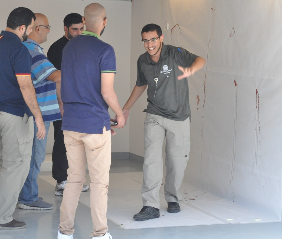 Team at mock scene doing bloodstain pattern analysis and reconstruction_b.JPG