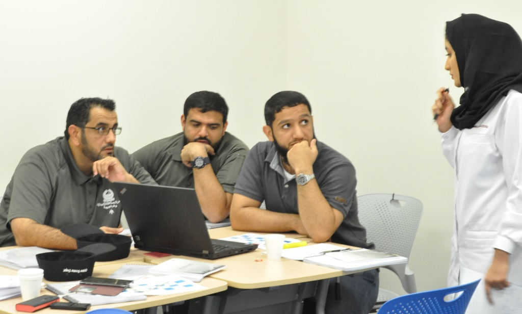 Team reviewing photographs and documentation of another team.JPG