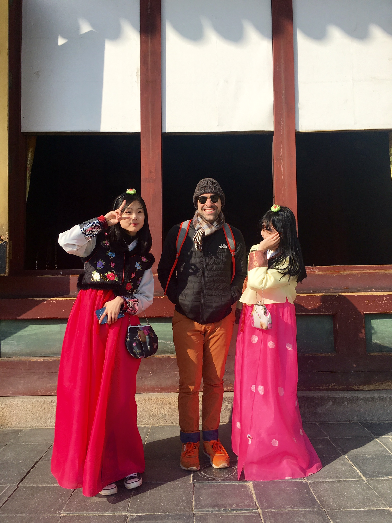 2 very strange girls, in traditional Korean clothing called Hanbok.