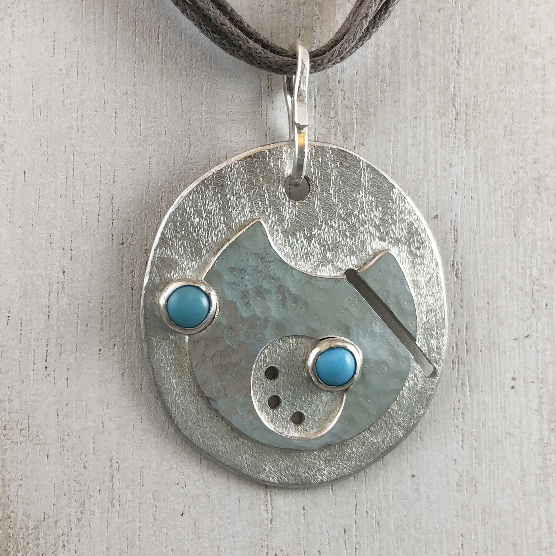 """Gallifreyan (language from Doctor Who®) """"LOVE"""" Pendant. Textured sterling silver with set turquoise cabs."""