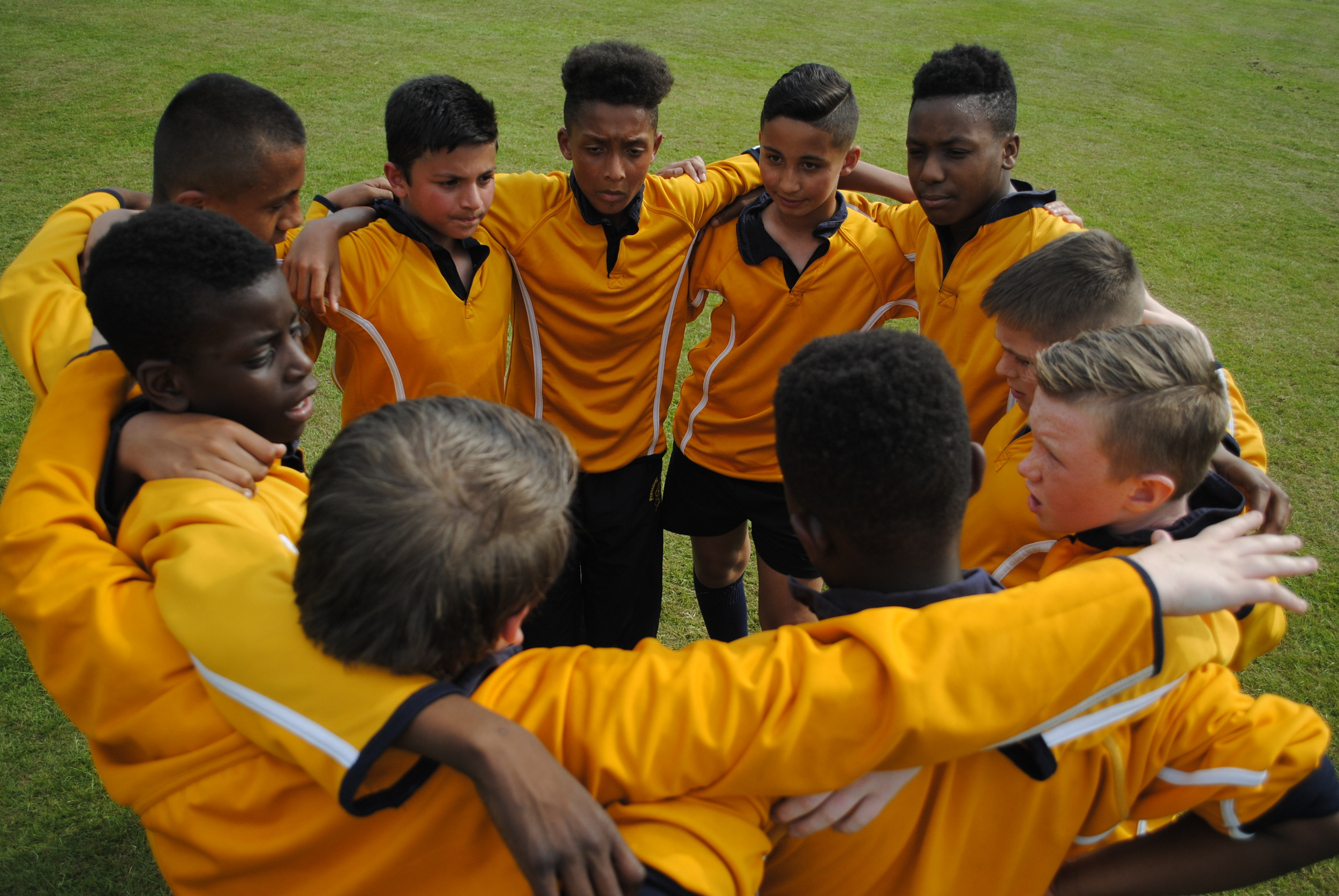 President Kennedy players get themselves fired up for the second half