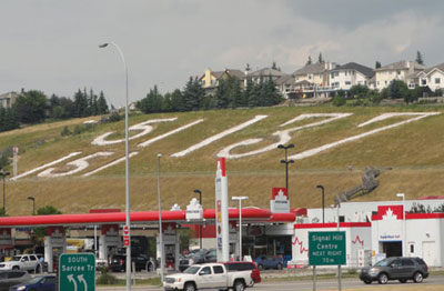 Figure 9-2. Signal Hill rock battalion numbers on hill above busy shopping centre, 2014.