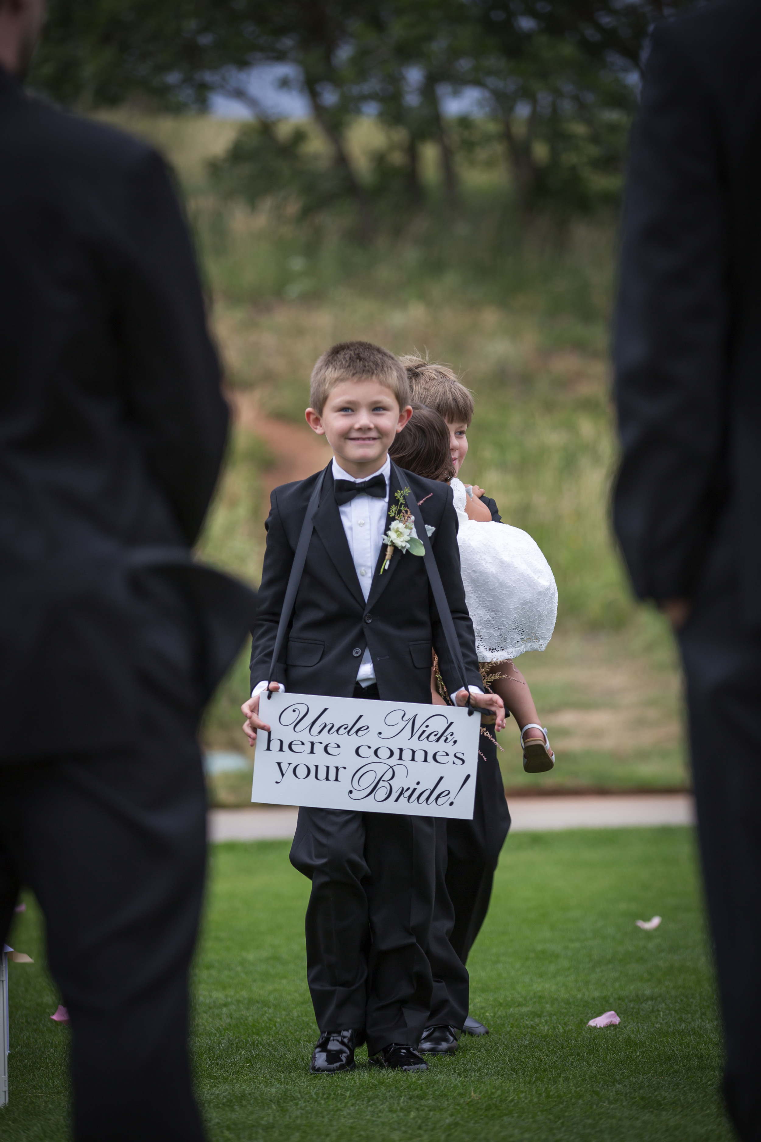 """My nephew carrieda sign that said.... """"uncle nick, here comes your bride"""". ordered off etsy"""