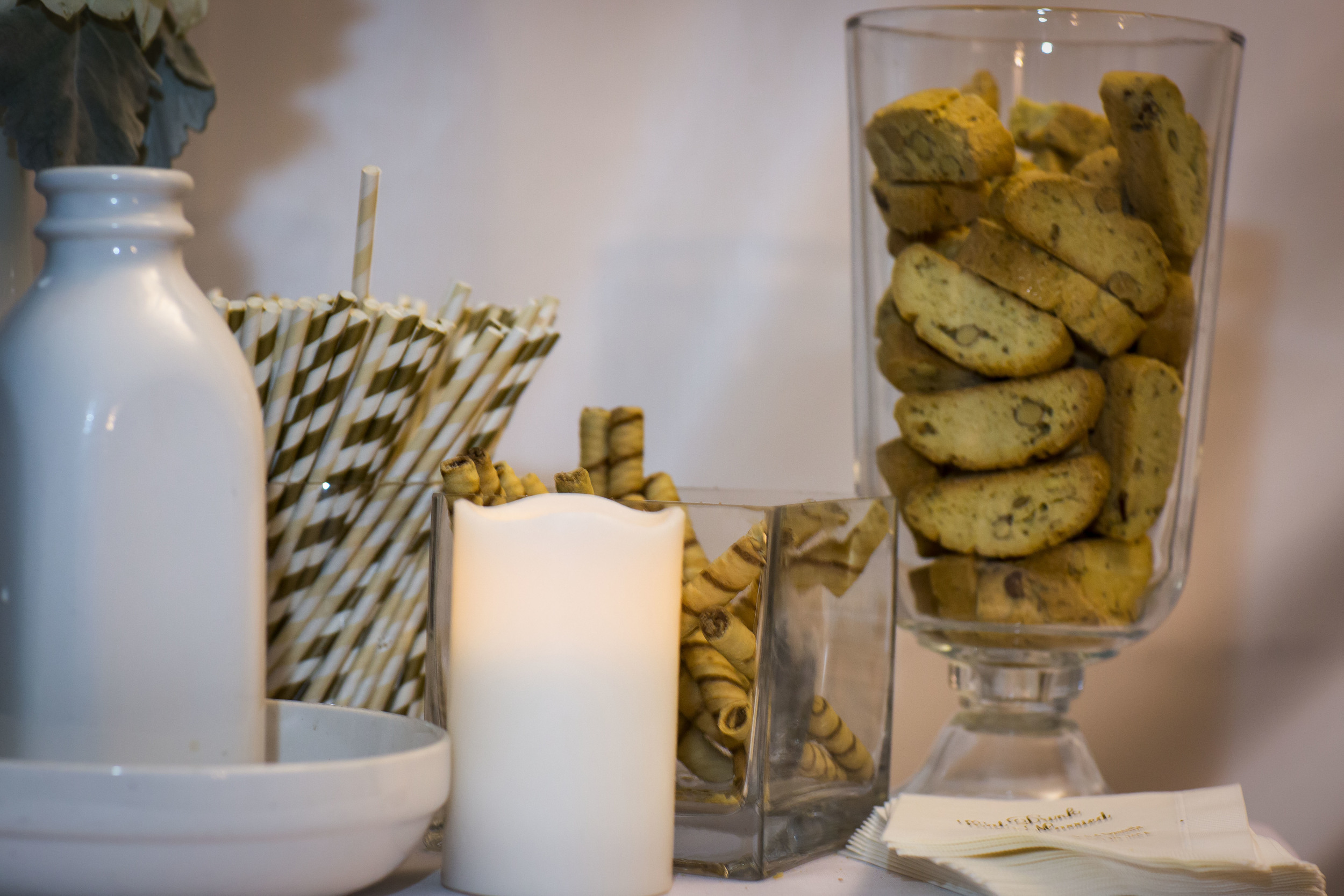 we had a coffee bar with biscottis,chocolate pirouettes, straws that match the wedding, and personalized napakins.