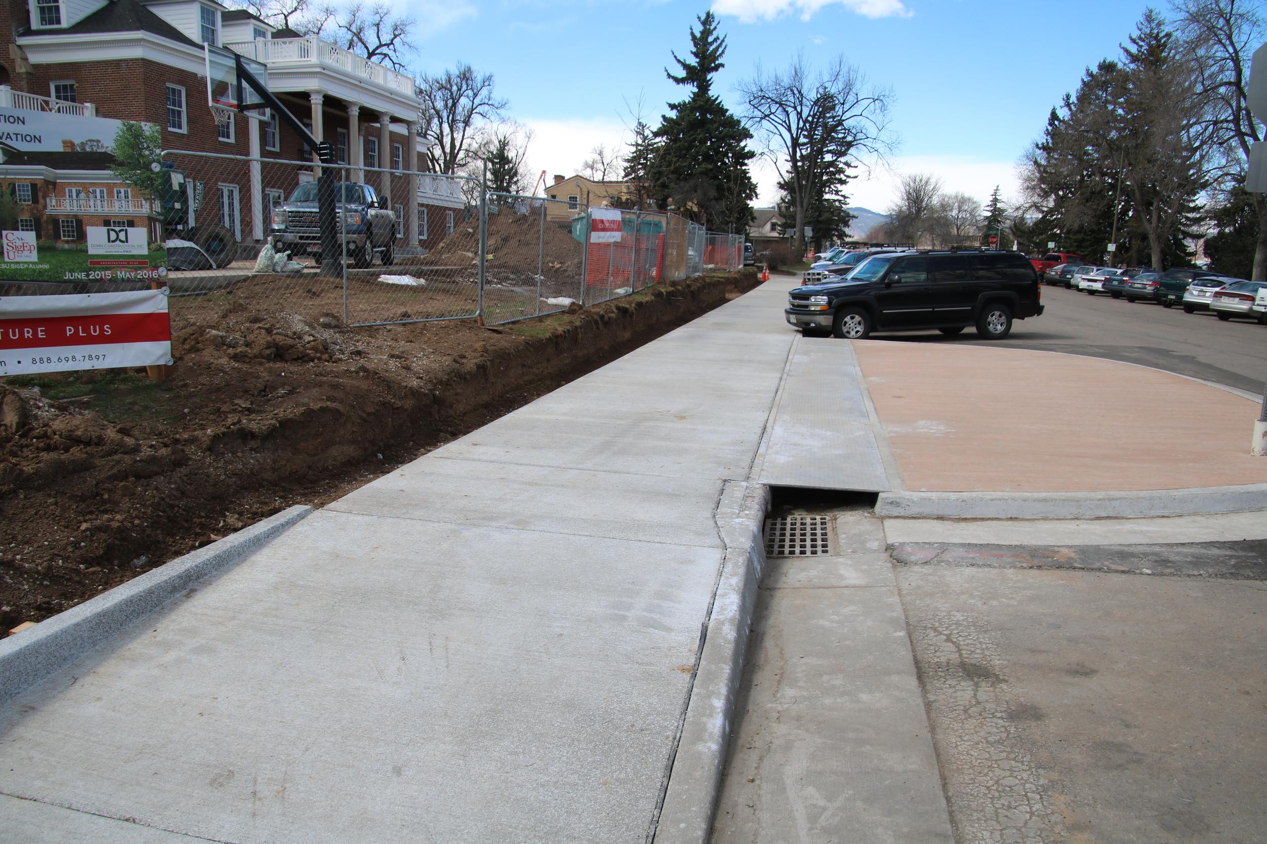 New front sidewalk with pedestrian island