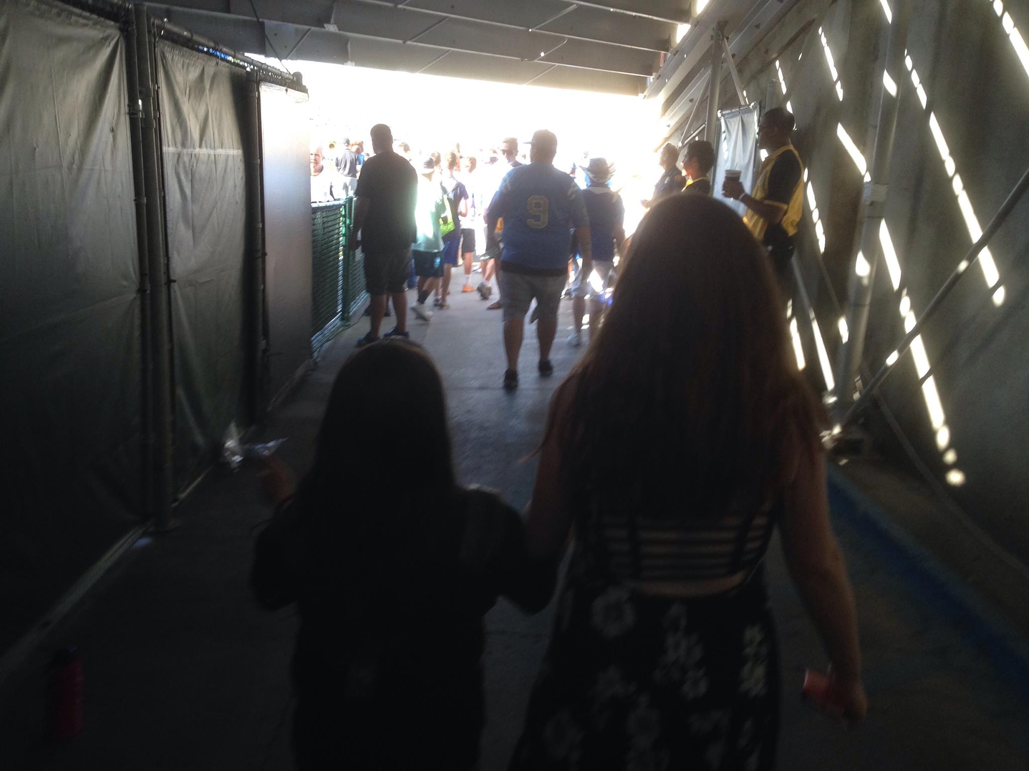 Abby walking out on the field at the Rose Bowl.