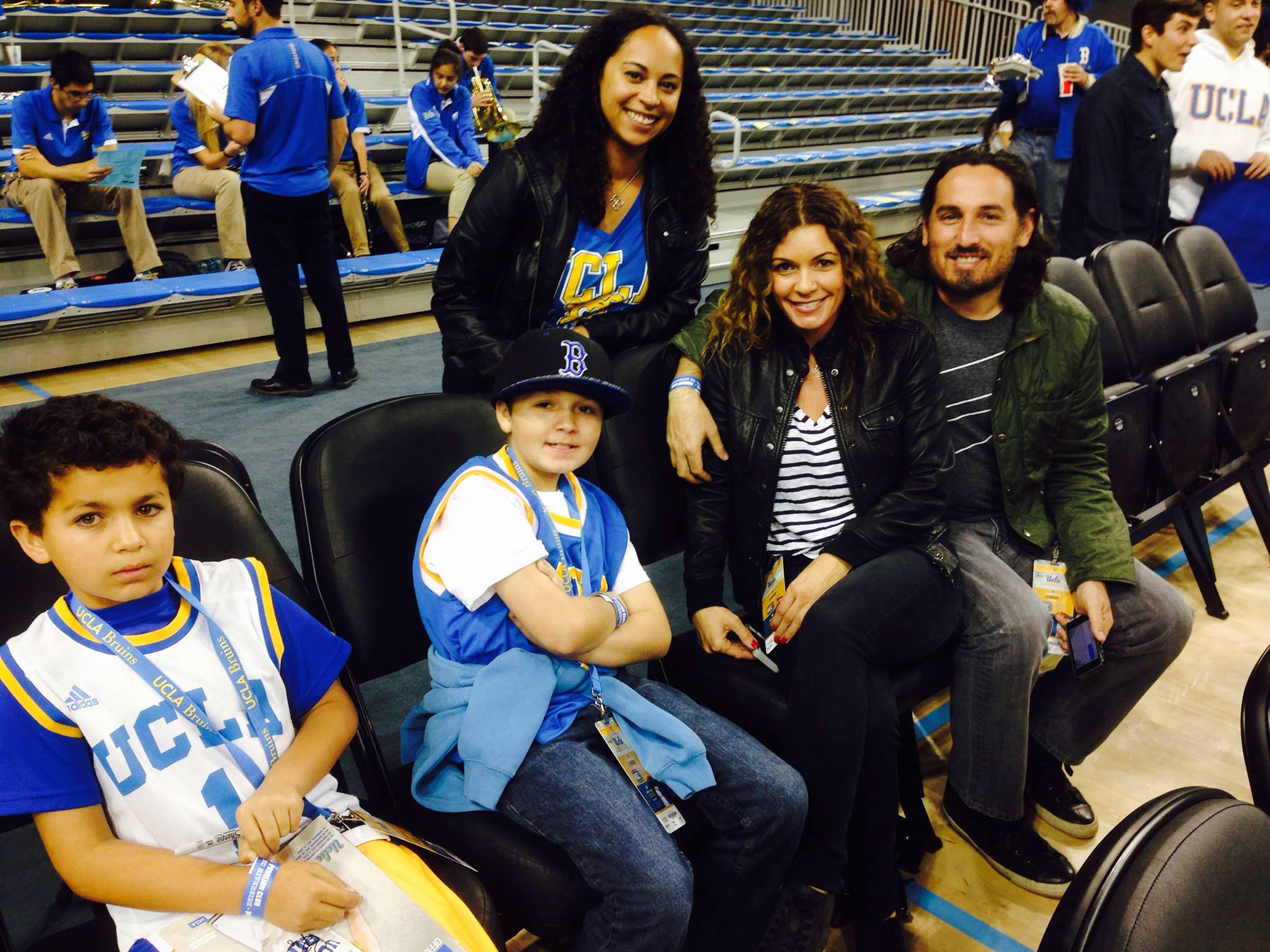 Logan with his family and friend, chilling like a villain in Pauley Pavillion.