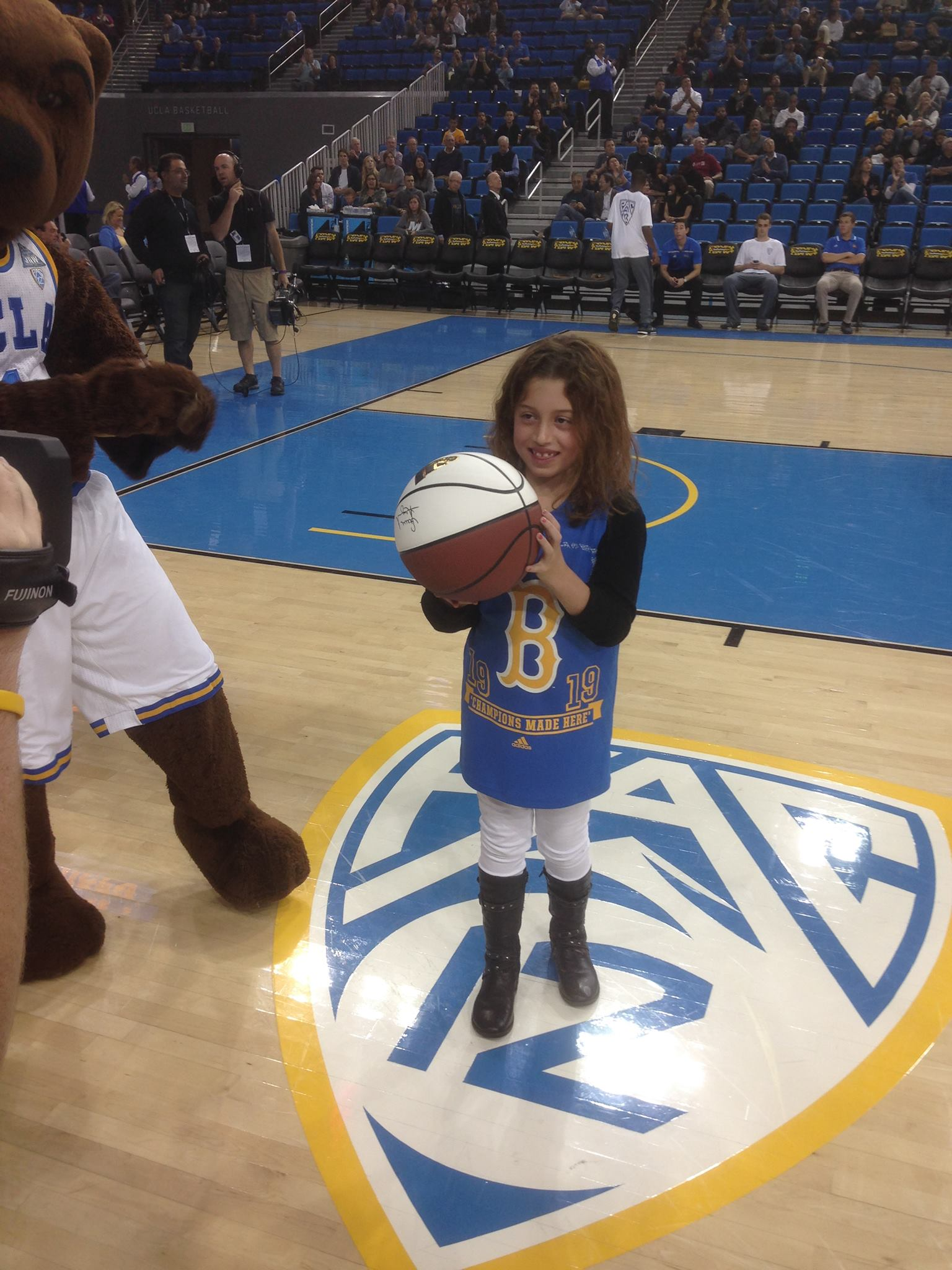 Blayke receiving the game ball as Kid Captain!