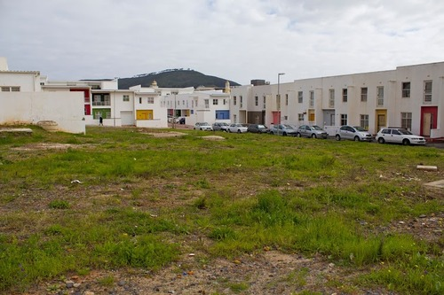 An empty lot behind District Six housing developments.   Photo credit: James Leyba