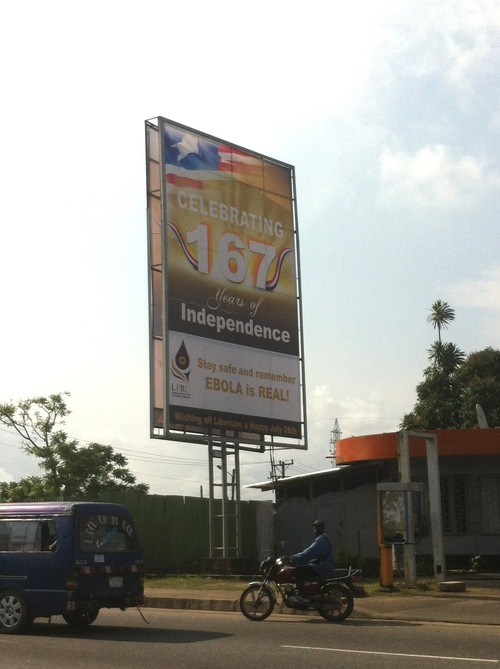 Sign marking the country's Independence Day warns Liberians about Ebola. ( Photo credit: Jennifer Majer)