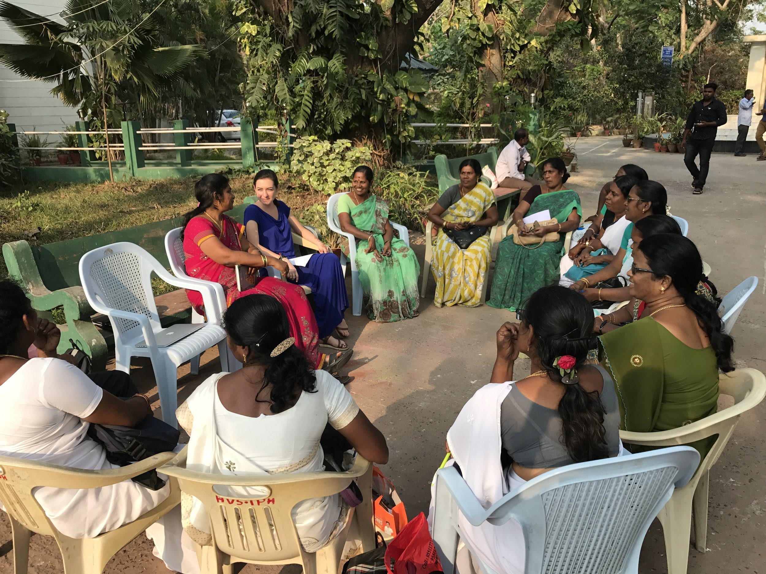 Chennai, India IDEV Practicum Team member Rose Fishman (second from left) conducts a focus group with VHNs at the Poonamallee IPH, assisted by Ms. Eswari (left). Focus groups were conducted toward the end of fieldwork to validate findings and to discuss proposed recommendations with the VHNs responsible for using data systems in the field.
