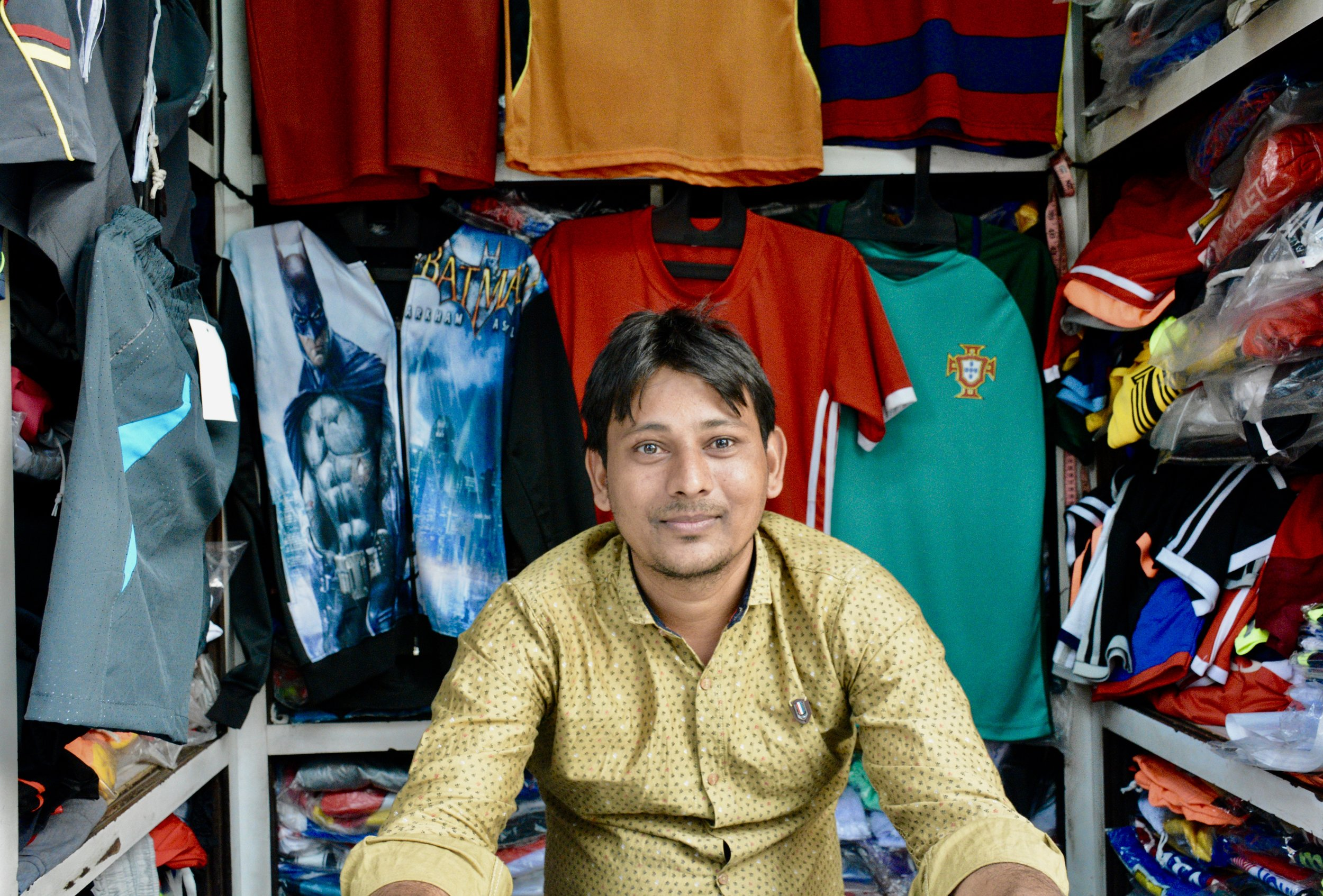 One of the Mumbai group's final interviews involved speaking to a young owner of a sports jersey stand who conducted 100% of his transactions in cash he had to lower some prices as a result of demonetization but does forsee adopting digital payment systems in the near future.