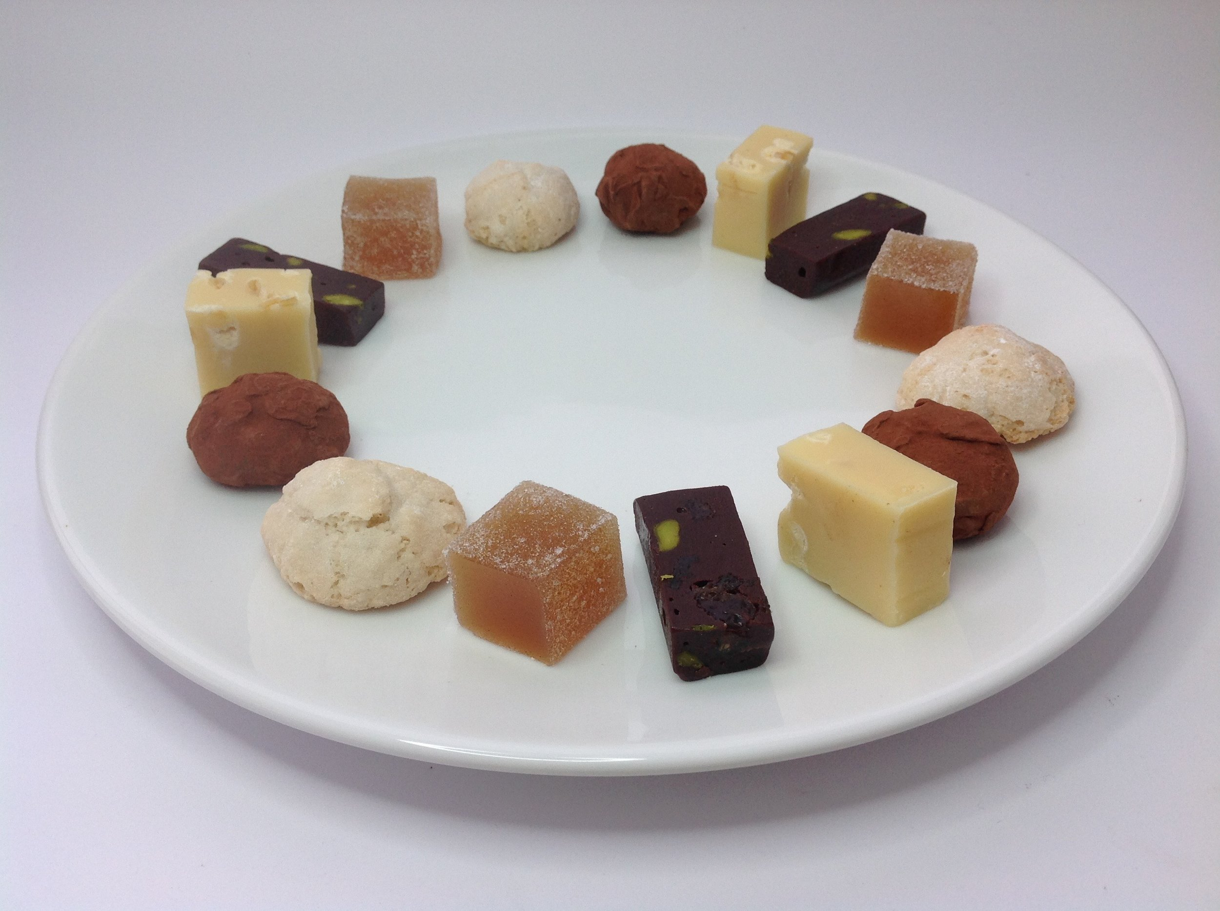 Petits Fours  Pear, Vanilla & Poire William Jelly Dark Chocolate, Pistachio & Raisin Fudge Salted Caramel & Peanut Truffle Amaretti Morbidi White Chocolate & Salted Lemon Fudge