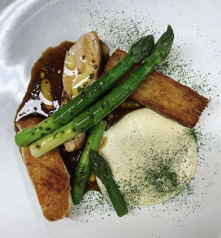 Roasted chicken breast, asparagus, truffle potato terrine, bread sauce