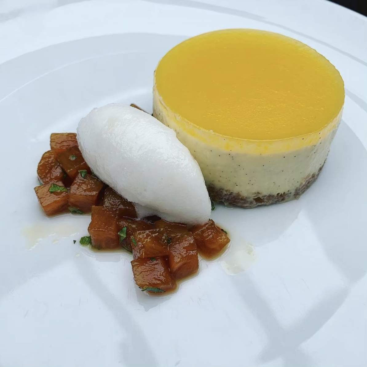 Baked pineapple and white chocolate cheesecake, poached pineapple, lime sorbet