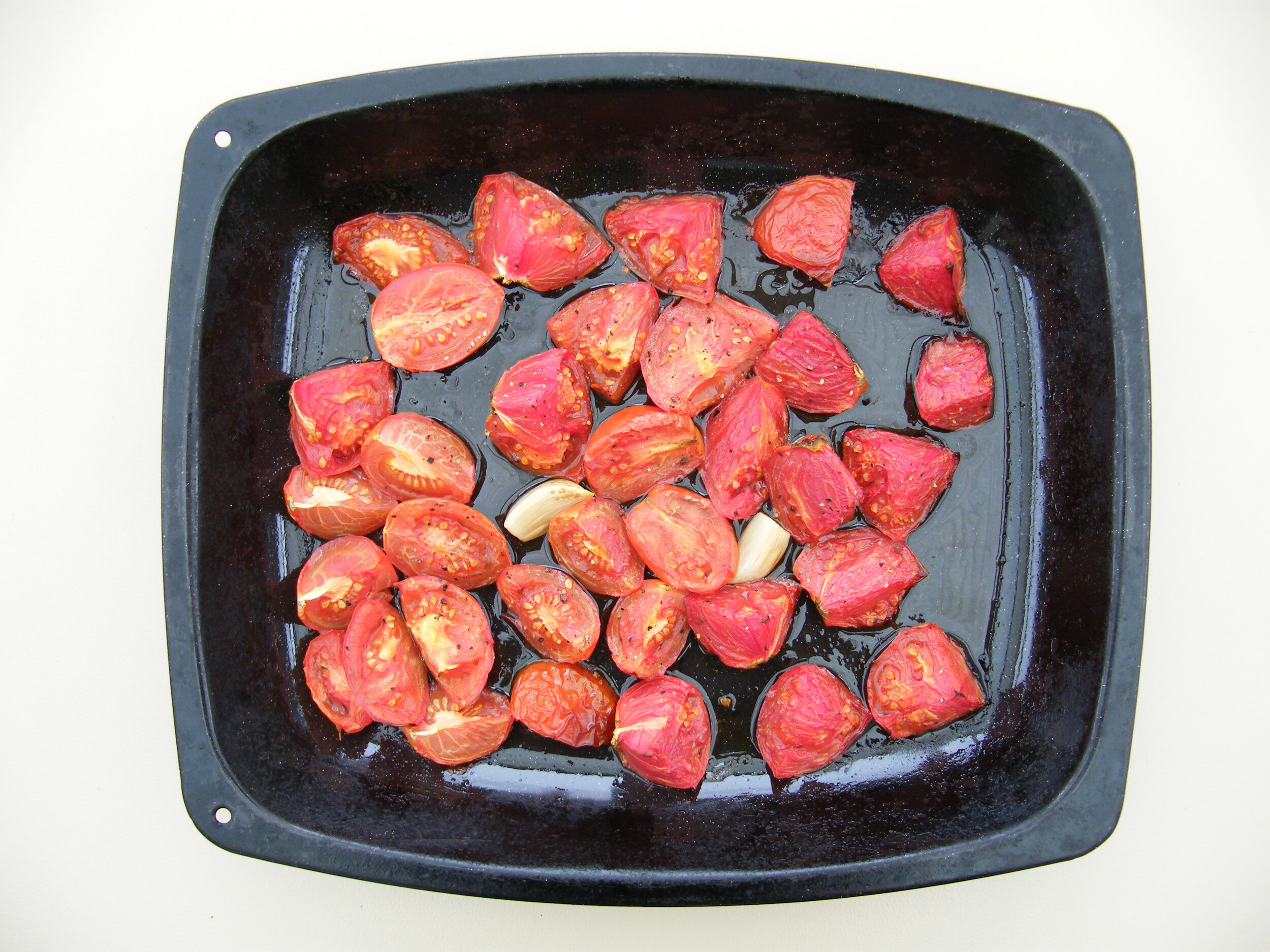 Roast 750g of roughly chopped tomatoes with two peeled garlic cloves in olive oil for 40 minutes at 180 degrees C.