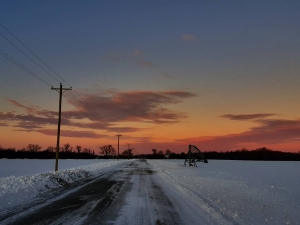 My cousin Jordana in Delaware took this photo of a snowy country road at sunset, and it makes me calm and homesick.