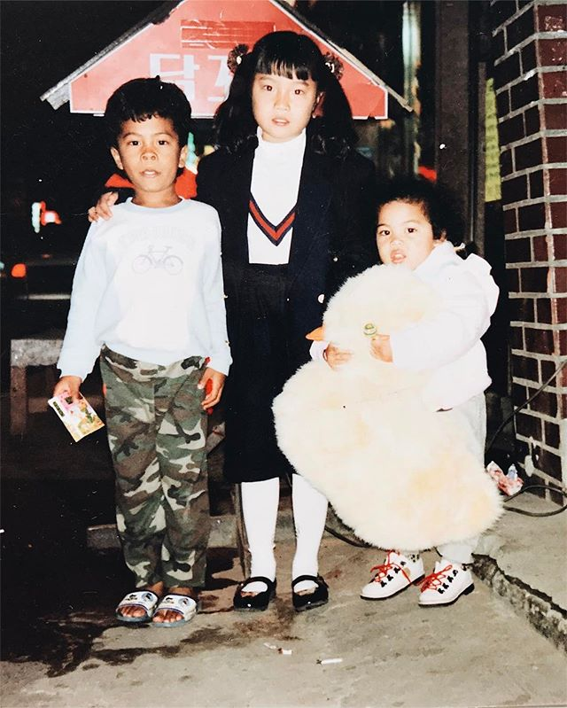 1992: my brother, cousin, and me somewhere in the streets of South Korea. Got myself a duck and a lollipop. #winning Also... I want those shoes. 😍