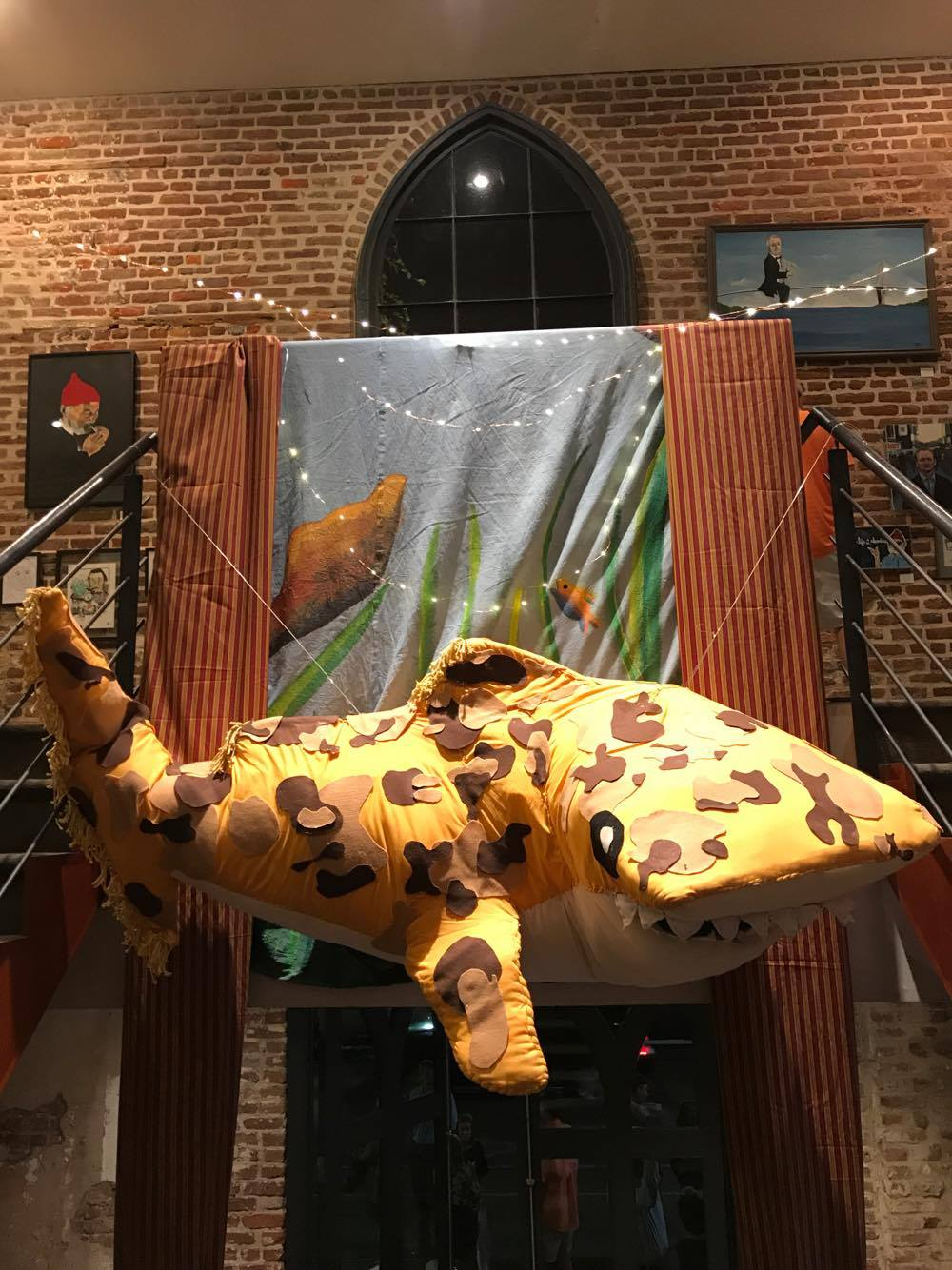 Approximately six feet in length, the Jaguar Shark from  The Life Aquatic  is crafted from a chicken wire frame, yellow and white material, cotton batting, yarn, and felt for the Summer of Bill film screening at the Charleston Music Hall.