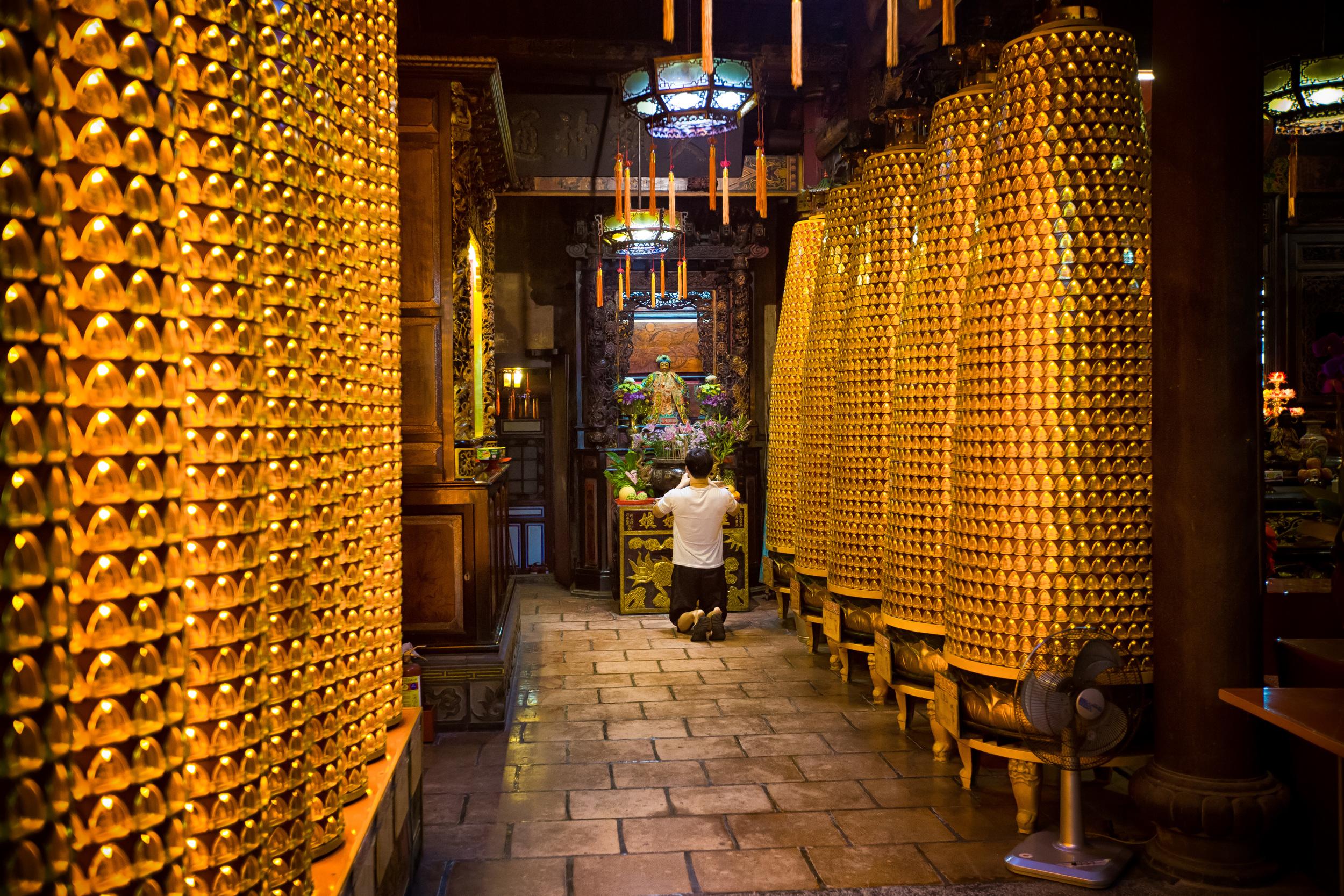 A Taiwanese man praying at an altar in Ciyou Temple (  慈祐宮)
