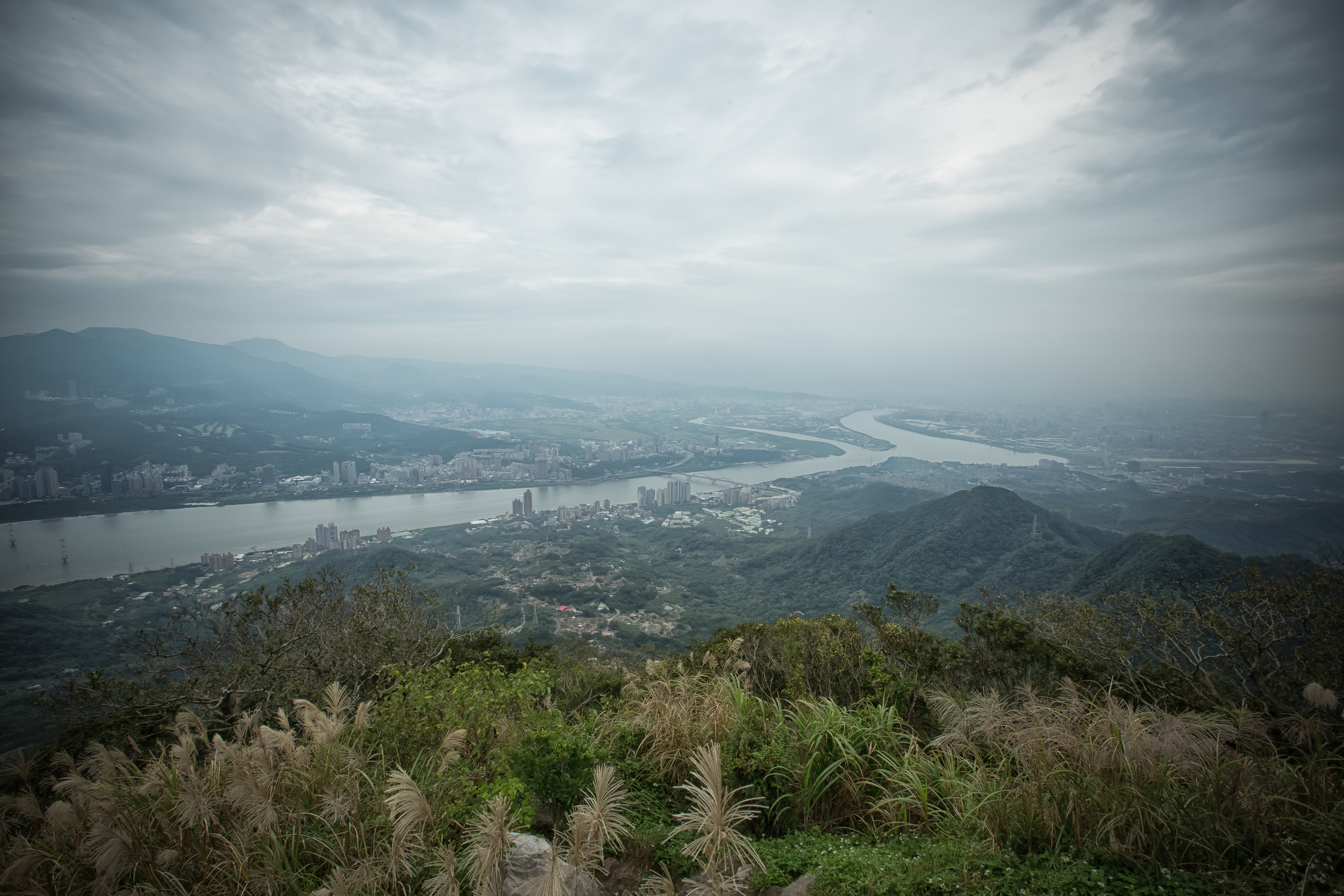 - Looking towards a hazy Taipei from the peak of Guanyin Mountain
