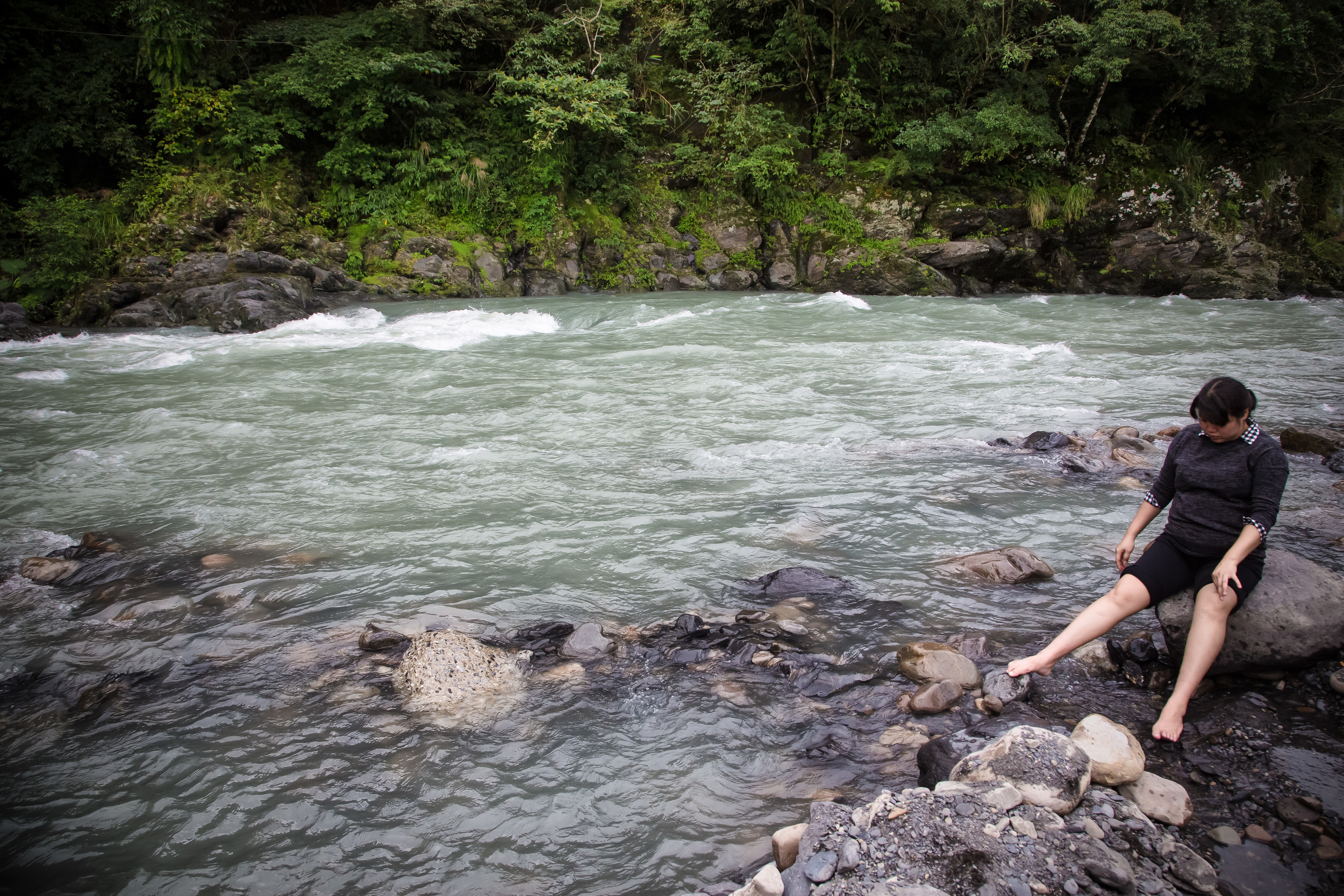 A Taiwanese woman dipping her feet in the hot spring water