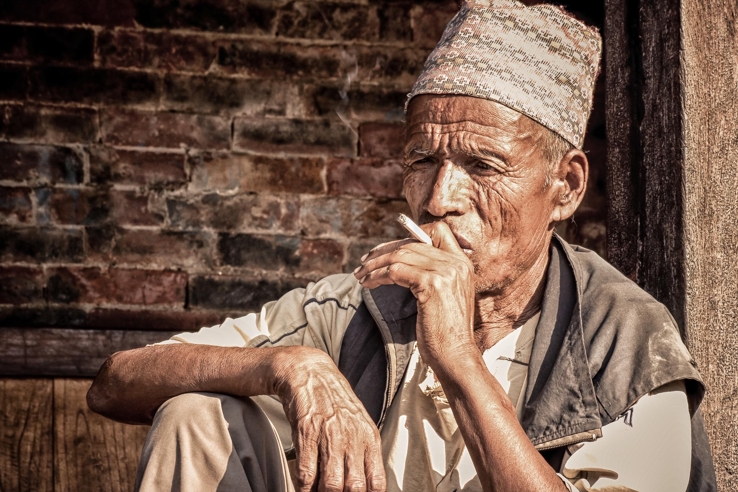 - A Nepali potter taking a cigarette break on a hot day in Bhaktapur, Nepal