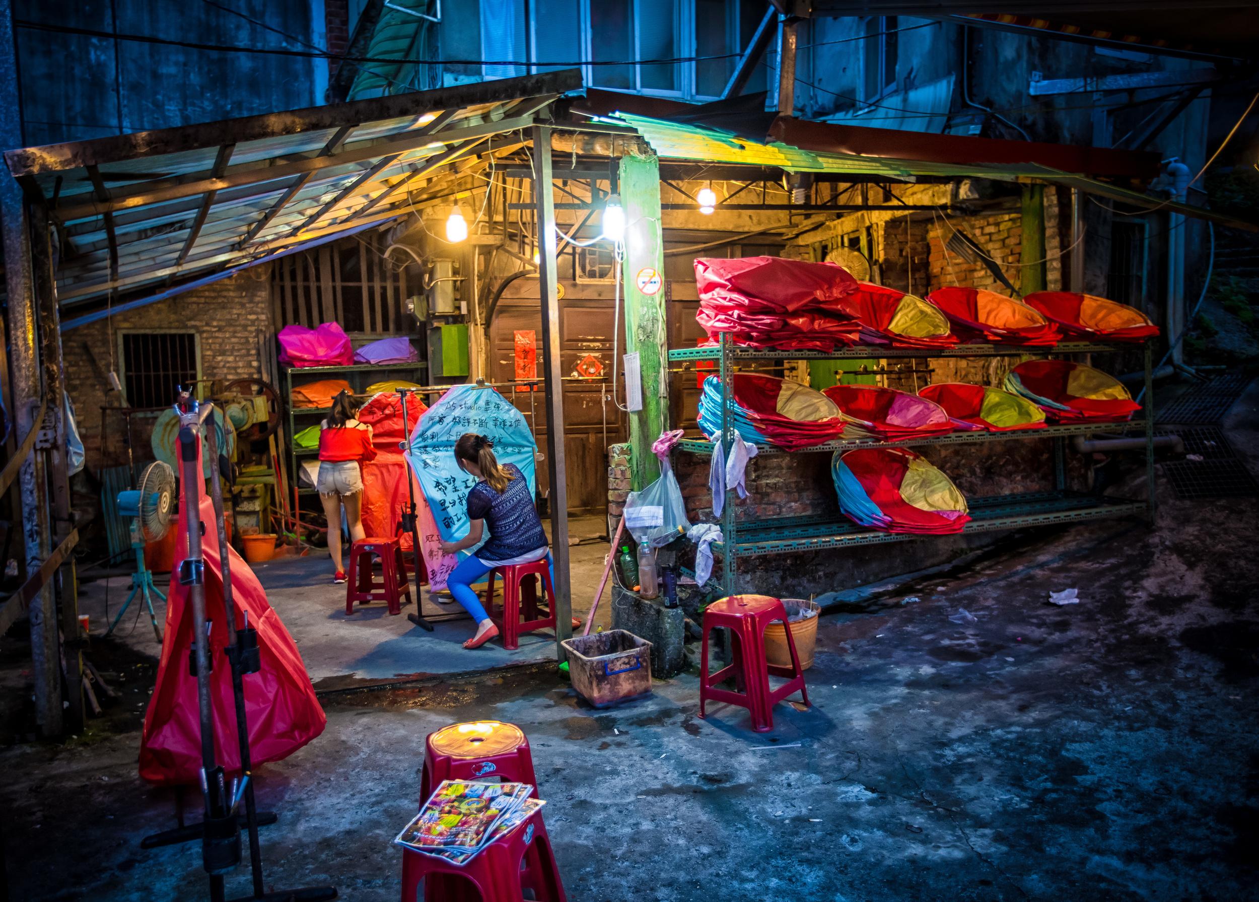 - A Taiwanese woman preparing a sky lantern in Pingxi