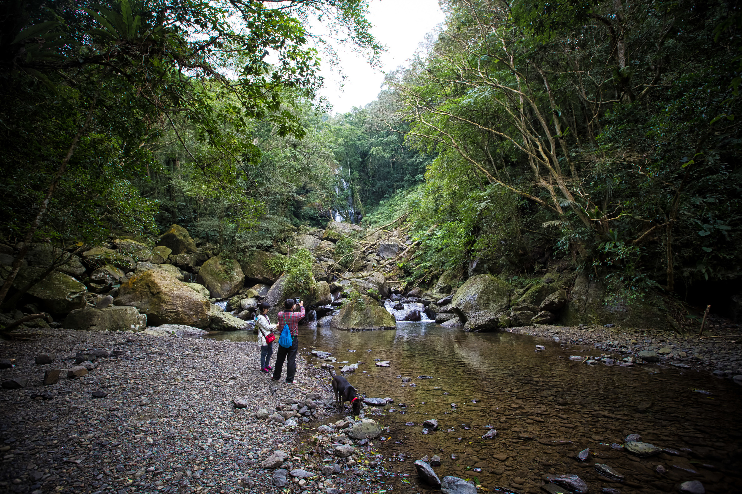 - Taiwanese hikers at the stream below the waterfall