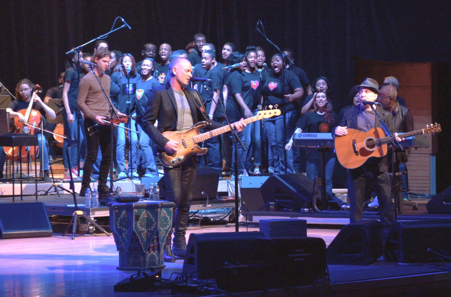 Sting and Paul Simon with Duke Ellington students onstage at Strathmore Hall at 2014's Performance Series of Legends. the 2015 benefit features bobby McFerrin at the warner theatre on may 20.