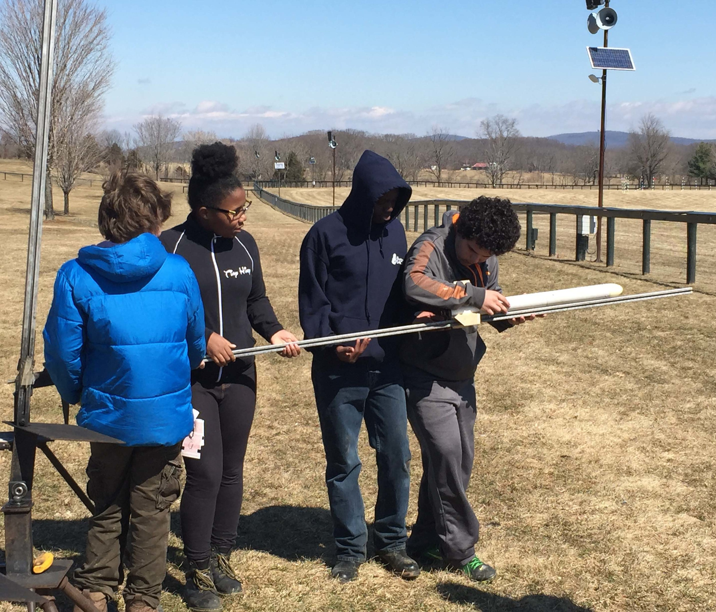 Collaborative team efforts get the rocket set up for a trial launch at The Plains, VA.