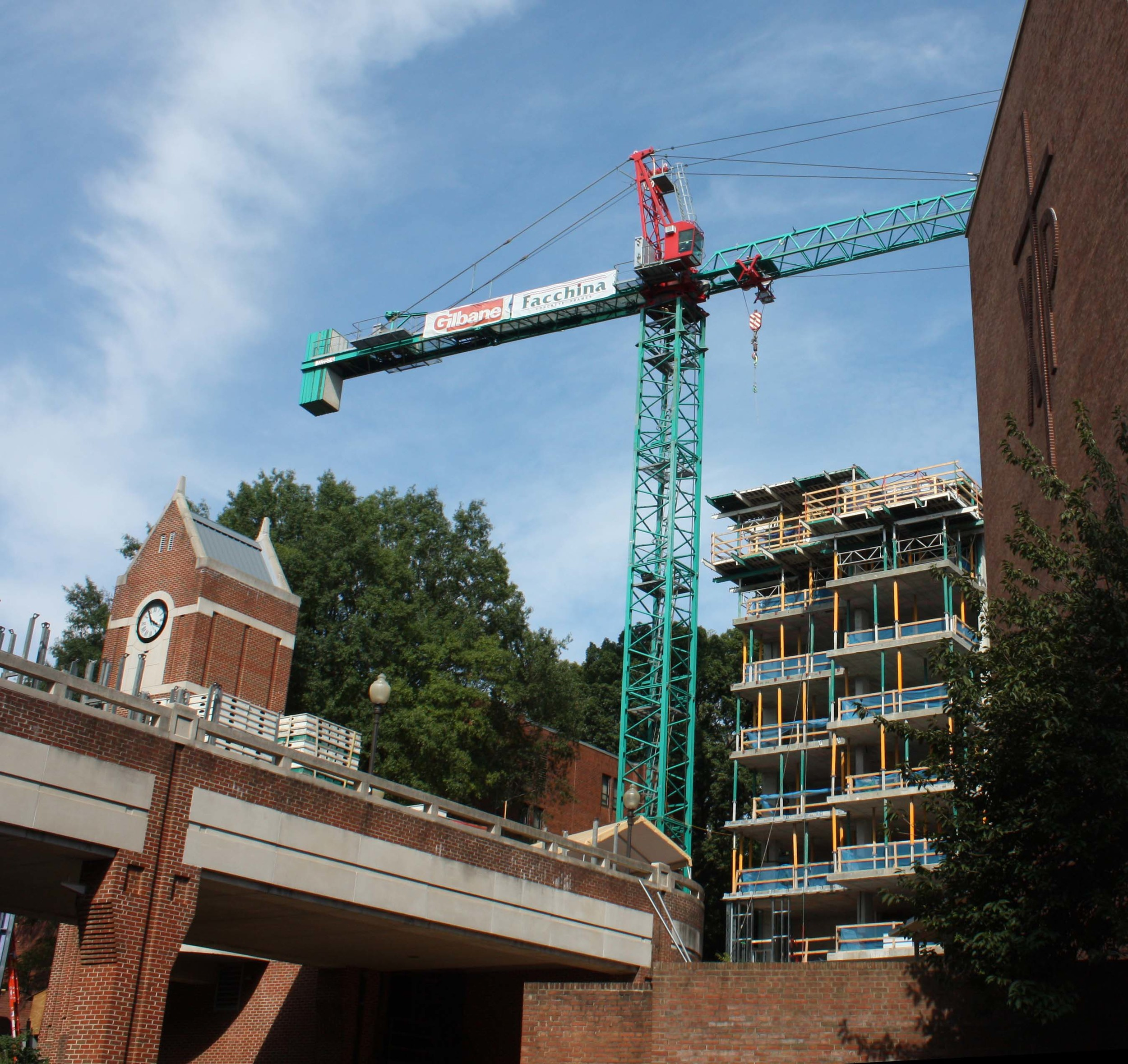 Construction cranes, such as this one at northeast triangle residence hall, loom over the campus skyline.
