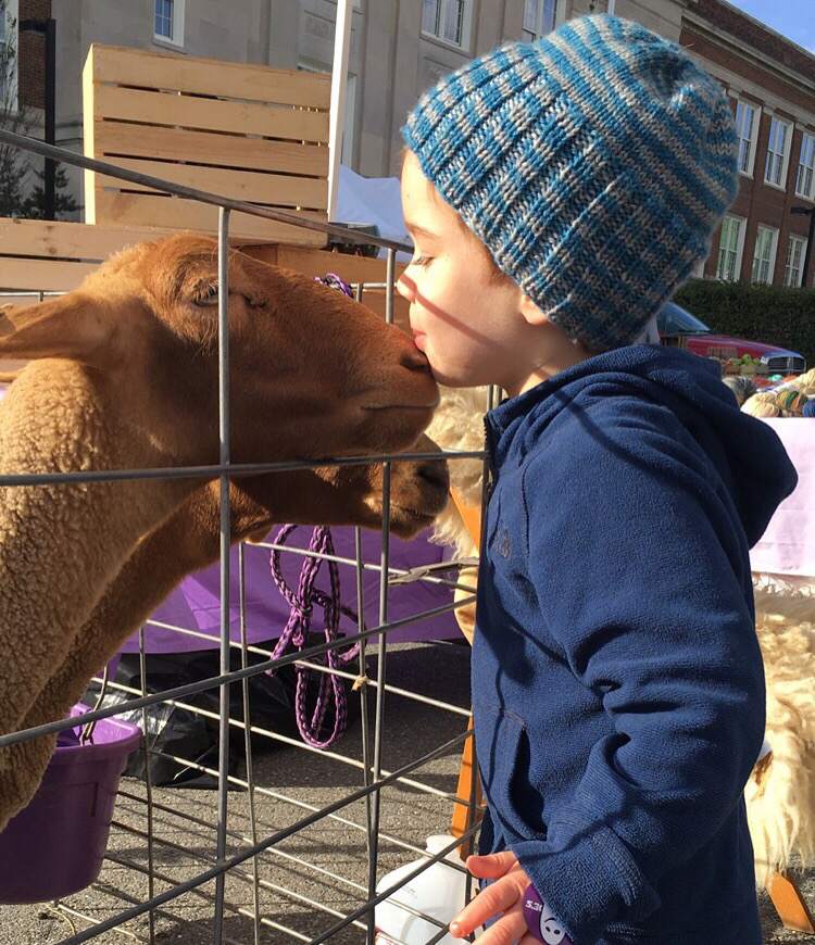 A farewell kiss at Fiber Arts Festival's mini petting zoo!