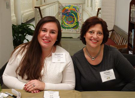 New employees Rebecca Risser and Michele Parsonnet welcome guests.