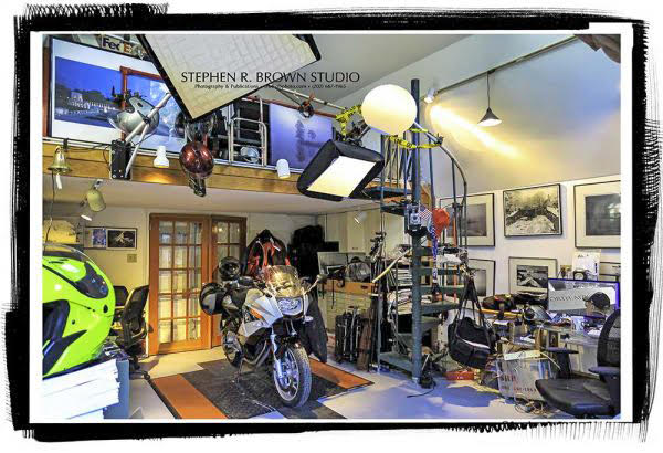 Stephen's photography studio also houses his motorcycle, which is easy to park when he works on the mall and downtown.